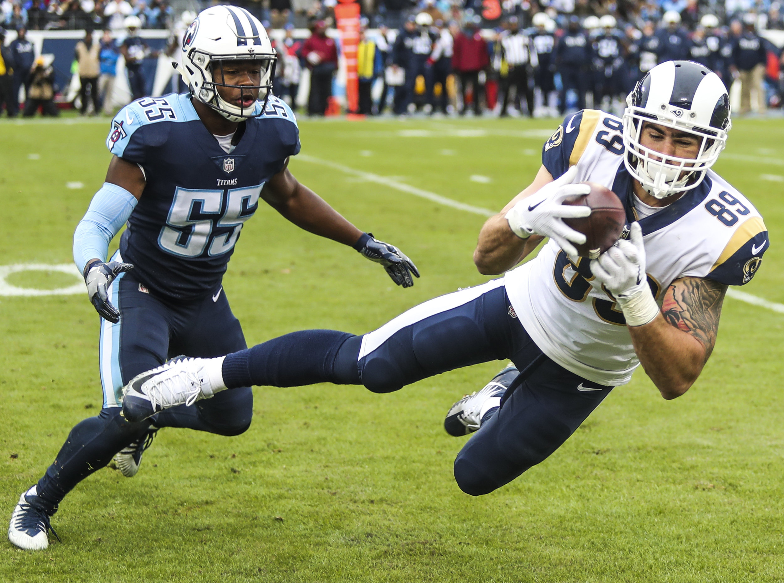 Los Angeles Rams tight end Tyler Higbee makes a diving catch Sunday while covered by Tennessee Titans linebacker Jayon Brown during the Rams' 27-23 win at Nissan Stadium in Nashville.