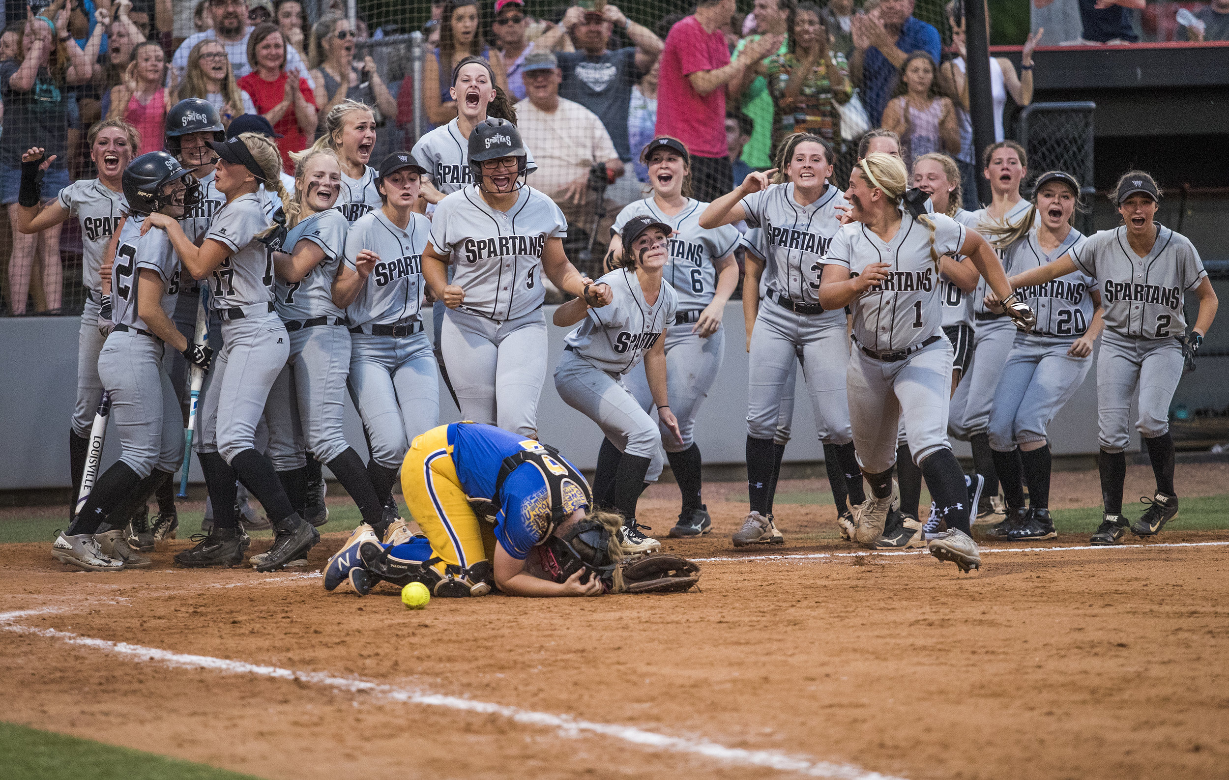 Warren East catcher Kendall Smith reacts as South Warren scores the game-winning run during the Region 4 championship on Thursday, June 1, 2017, at the WKU Softball Complex.