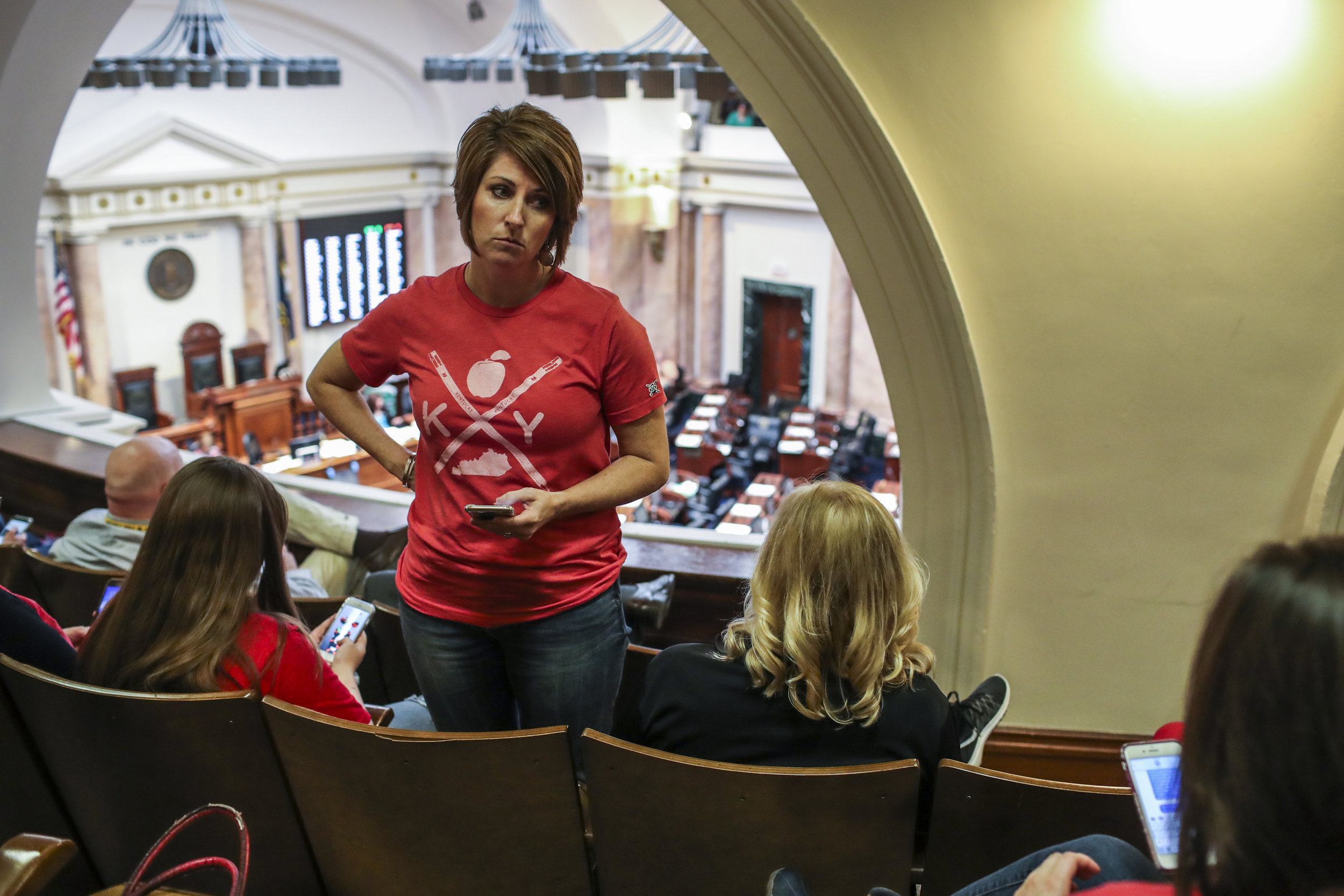Kelley Ross, an AP English teacher at Barren County High School, waits for a recess to end in the state House of Representatives on Friday, April 13, 2018, at the Kentucky State Capitol.
