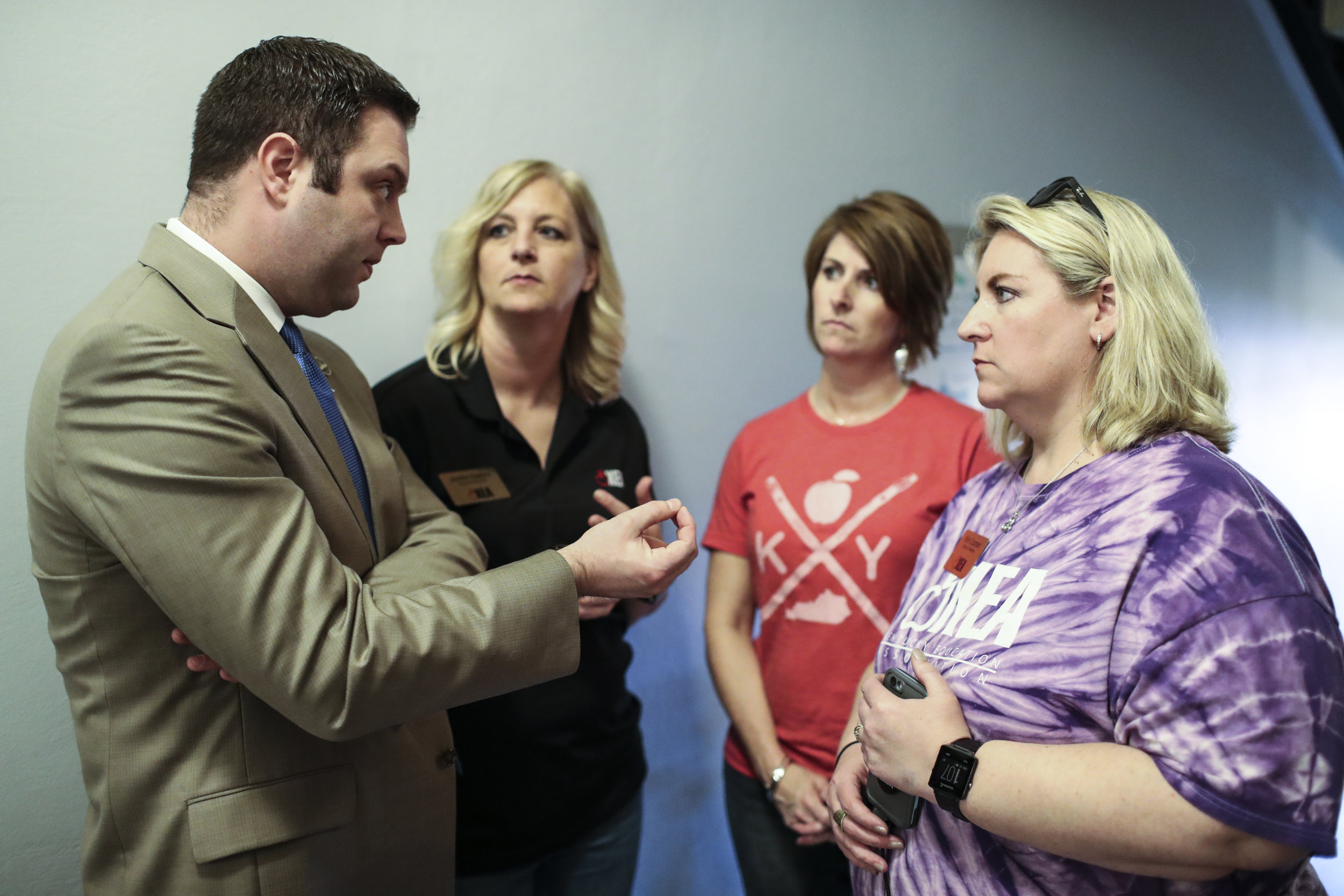 From right, Kim Coomer, Career Specialist at Warren County ATC, Kelley Ross, AP English teacher at Barren County High School, and Jennifer Hawkins, preschool teacher at Cumberland Trace Elementary School talk to state Rep. Michael Meredith, R-Brownsville, on Friday, April 13, 2018, at the Kentucky State Capitol.