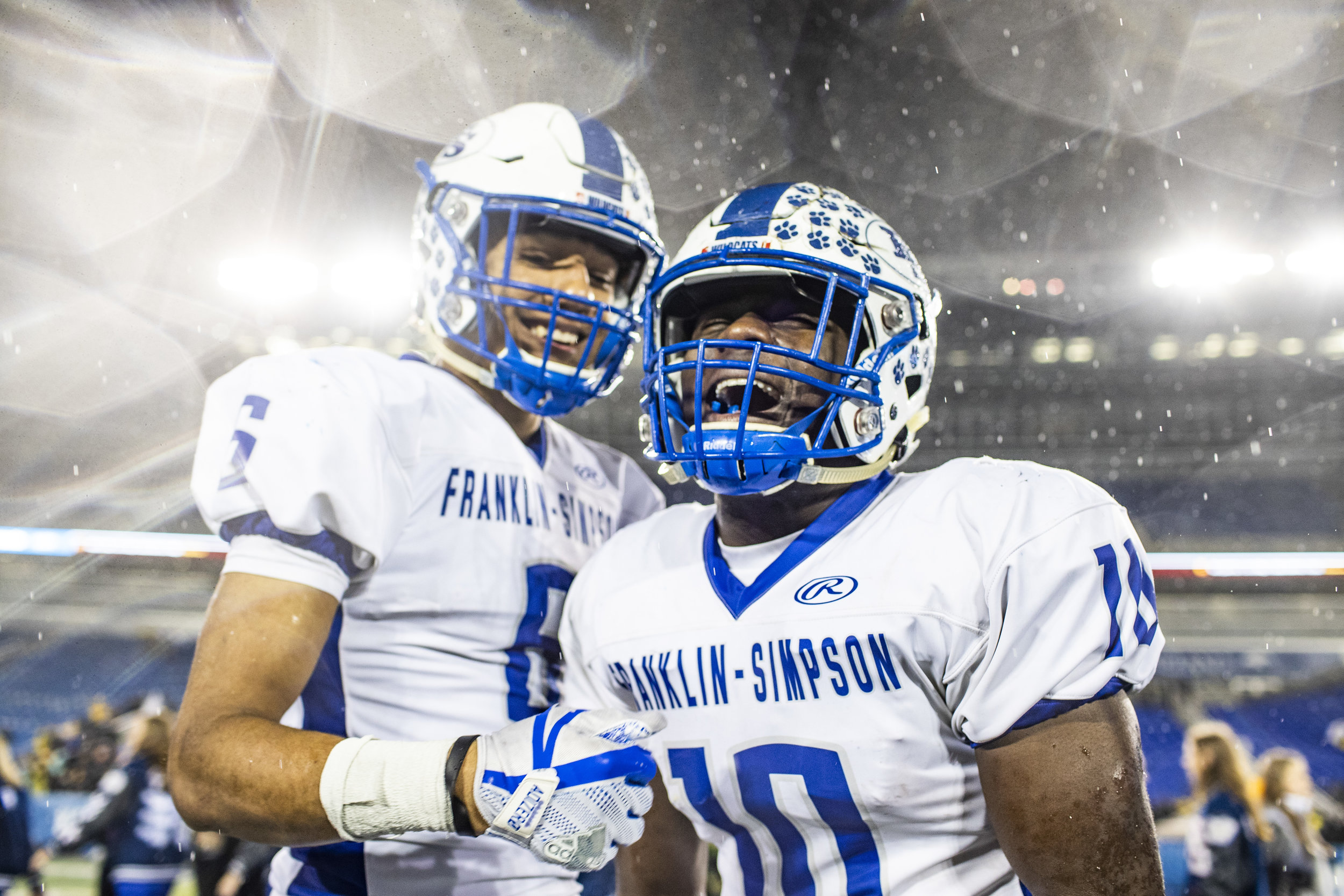 Franklin-Simpson's Leandre Stutzman, left, and Tre Bass celebrate after Franklin-Simpson's 14-12 win over Johnson Central in the Class 4A State Championship on Saturday, December 1, 2018, at Kroger Field in Lexington, Ky.