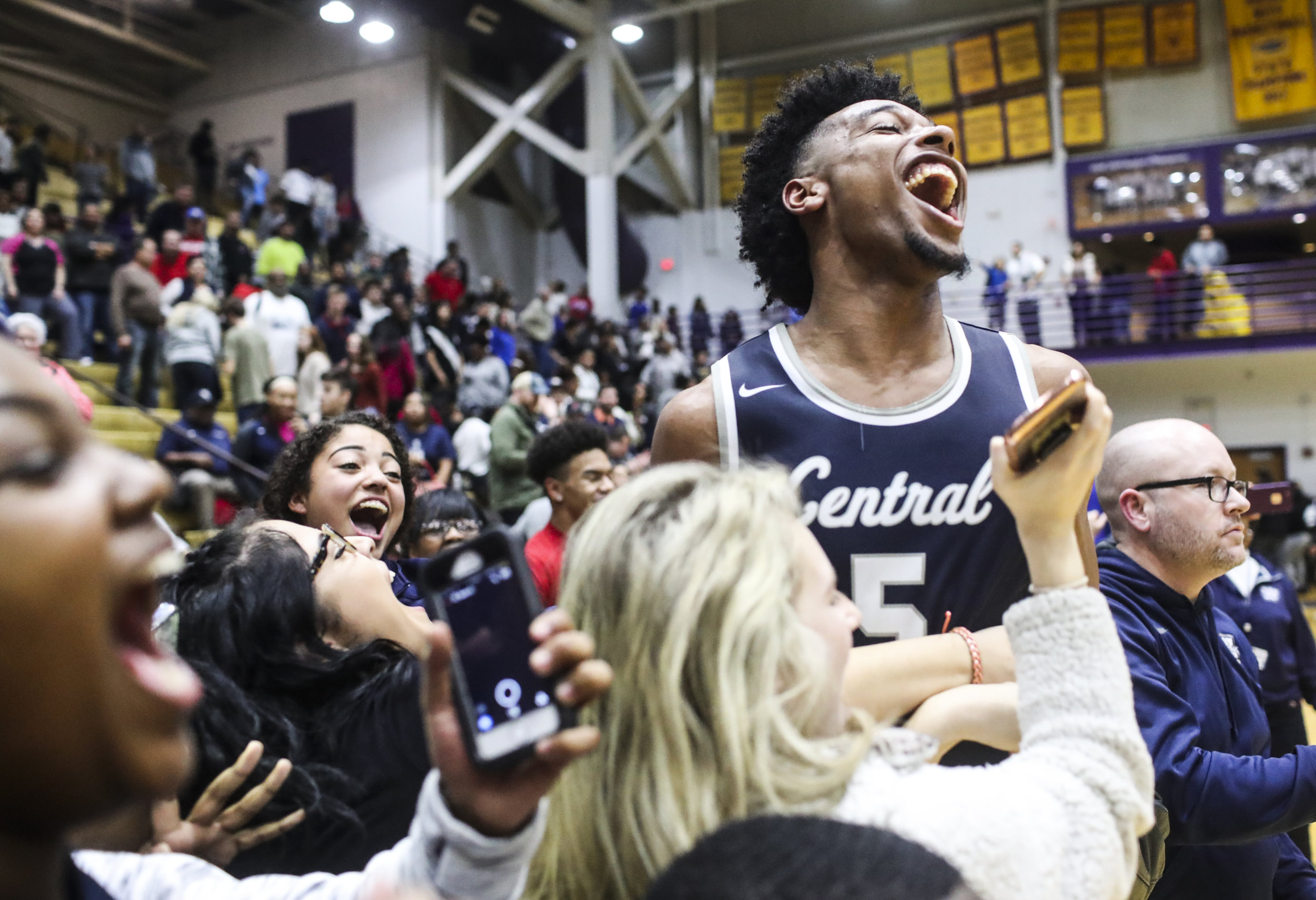 Warren Central's Skyelar Potter celebrates with fans after Warren Central's 66-56 win over Bowling Green on Thursday, January 11, 2018, at Bowling Green.