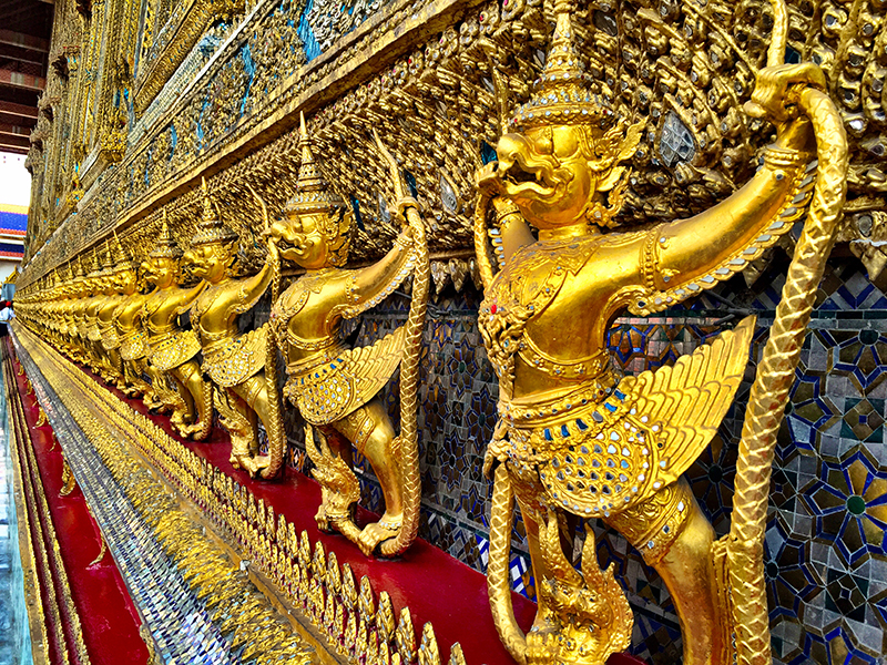 Golden guardians protecting The Temple of the Emerald Buddha