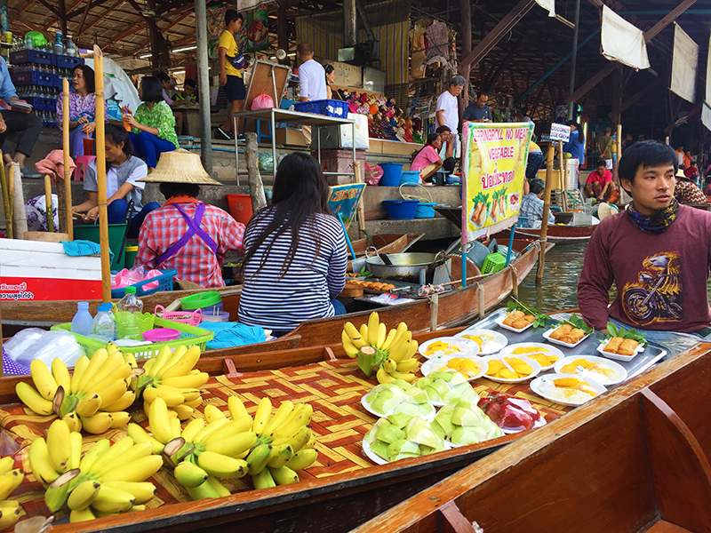 Locals selling fruit on long tail canoes. Best purchase: mango sticky rice + coconut ice cream