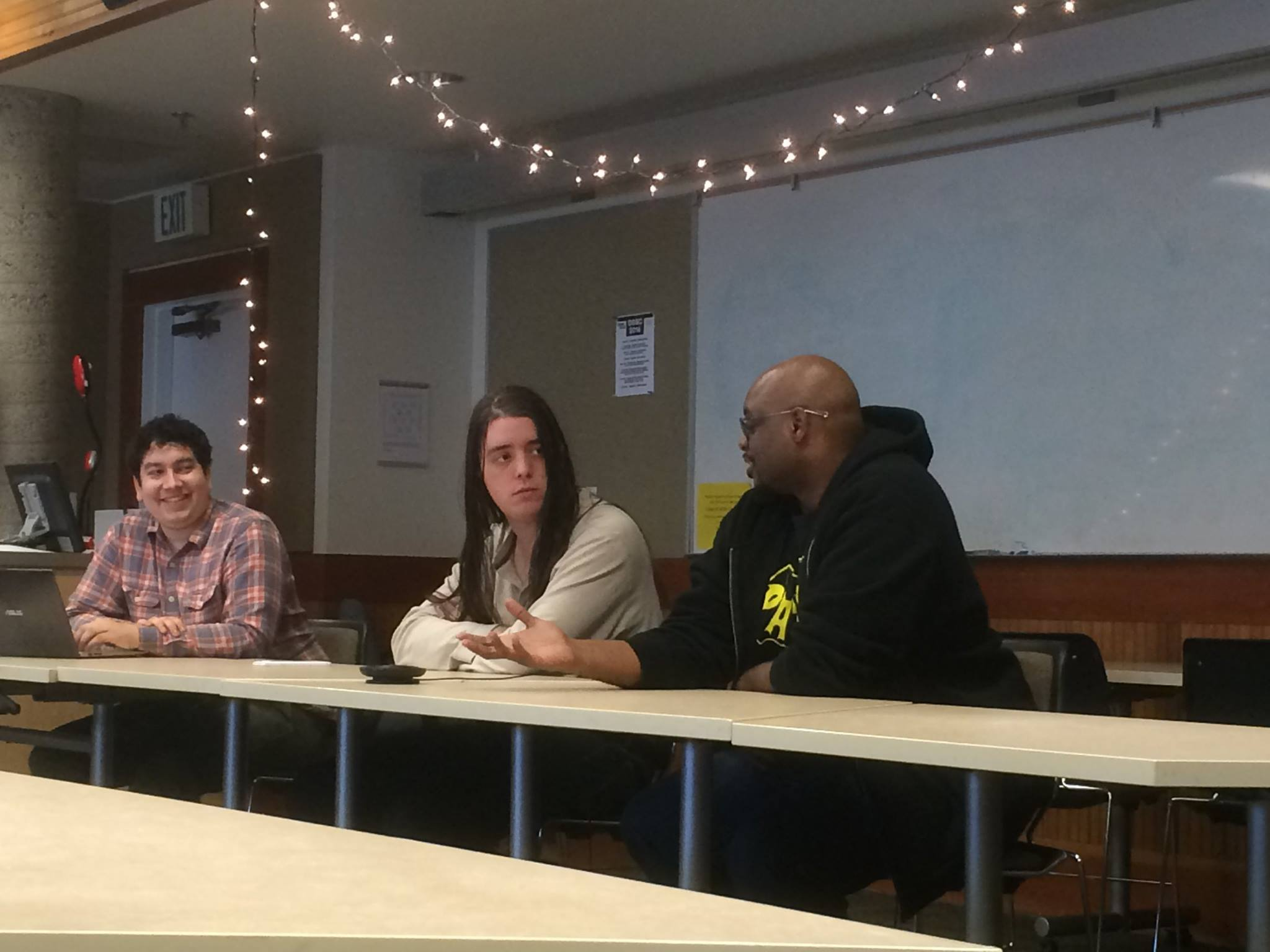 Myself, Austin Howe, and Kahlief Adams, in the 'Games & Society' panel.