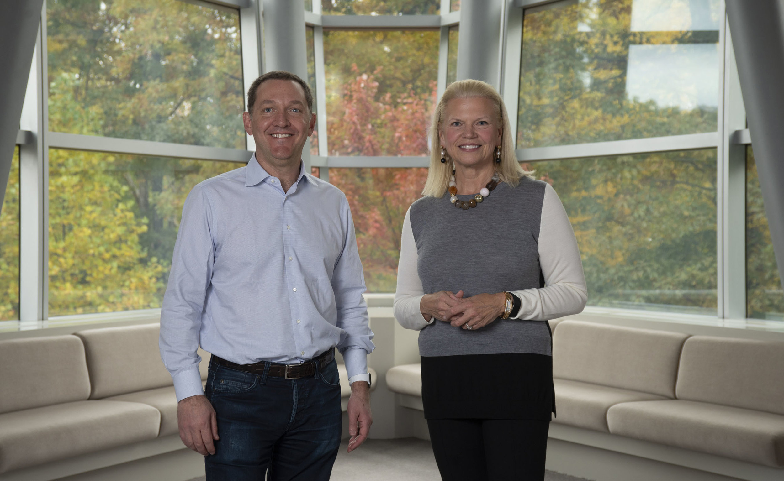 Ginni Rometty, Chairman, President, and CEO of IBM, at right, and James M. Whitehurst, CEO of Red Hat, left.