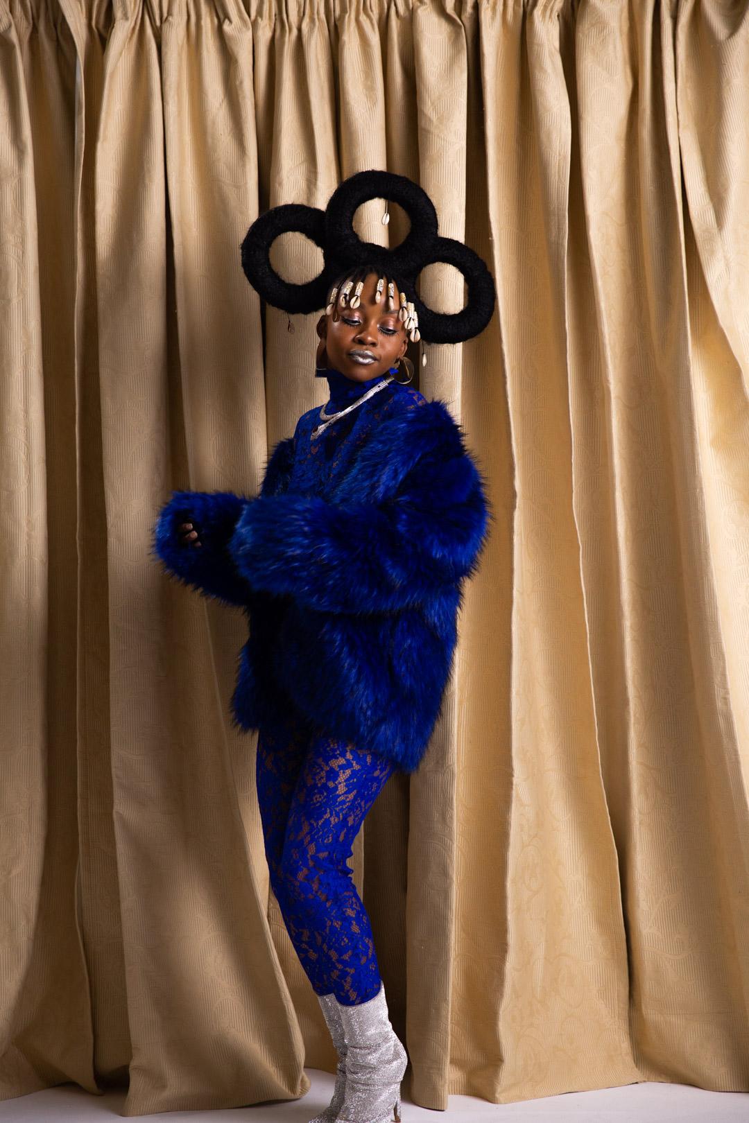 mwanje-blue outfit.jpg