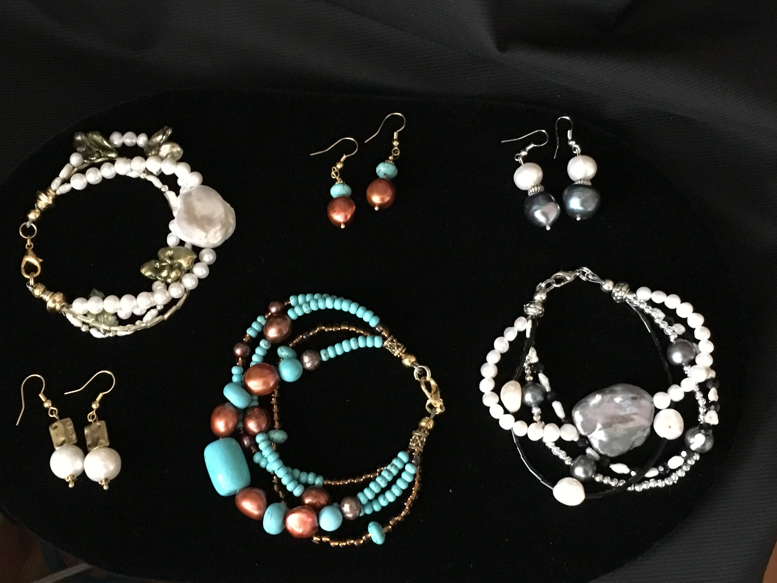 Four strand bracelets and earrings with raw fresh water pearls, turquoise and jet