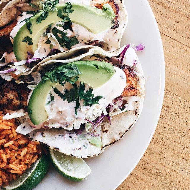 The Fish Tacos - Mahi Mahi, cabbage, and avocado on corn tortillas.
