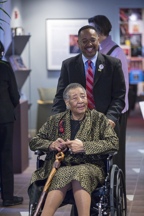 Dr. Rolando Herts of The Delta Center for Culture and Learning assists Mrs. Annyce P. Campbell as she arrives at the Smithsonian Anacostia Community Museum for the Delta Jewels program commemorating the National Park Service Centennial and Women's History Month. Mrs. Campbell is a native of Mound Bayou, MS. Her portrait appears on the cover of Alysia Burton Steele's Delta Jewels: In Search of My Grandmother's Wisdom, a collection of oral histories and photographs of African American church mothers from the Mississippi Delta. (Photo courtesy of Smithsonian Institution)