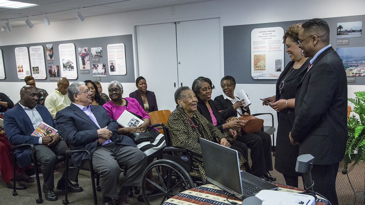 Alysia Burton Steele and Dr. Herts speak with Mrs. Campbell and guests before the Delta Jewels program begins at Smithsonian Anacostia Community Museum. (Photo courtesy of Smithsonian Institution)