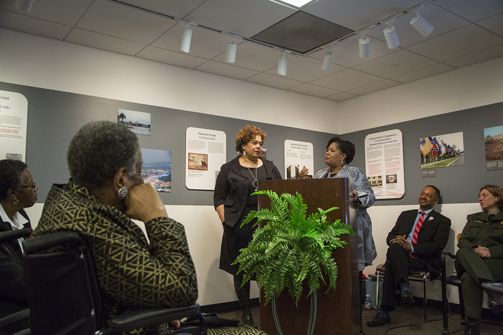 Reena Evers (right) speaks on behalf of her mother, Delta Jewel Myrlie Evers-Williams, commending Alysia Burton Steele for gathering and preserving untold stories of Mississippi Delta church mothers. (Photo courtesy of Smithsonian Institution)