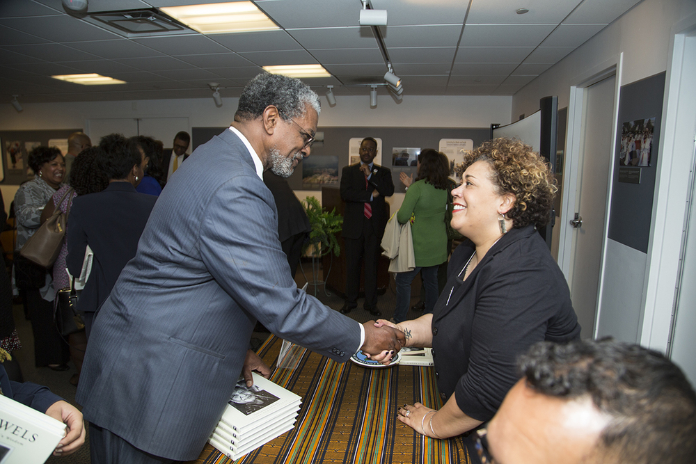 Alysia Burton Steele shakes hands with James Frazier, Chair of the Smithsonian Anacostia Community Museum Advisory Board. (Photo courtesy of Smithsonian Institution)