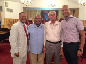 Dr. Rolando Herts (left to right) with mayor Darryl Johnson, Herman Johnson and filmmaker Keith Beauchamp.