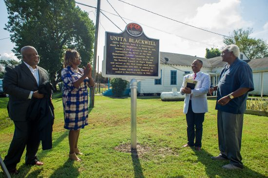 Congressman Bennie Thompson (left to right), Mayersville mayor Linda Short, Dr. Rolando Herts, director of the Delta Center for Culture and Learning, and Dr. Leslie McLemore, chair of the Mississippi Freedom Trail Task Force, stand in front of the newly unveiled Unita Blackwell marker.