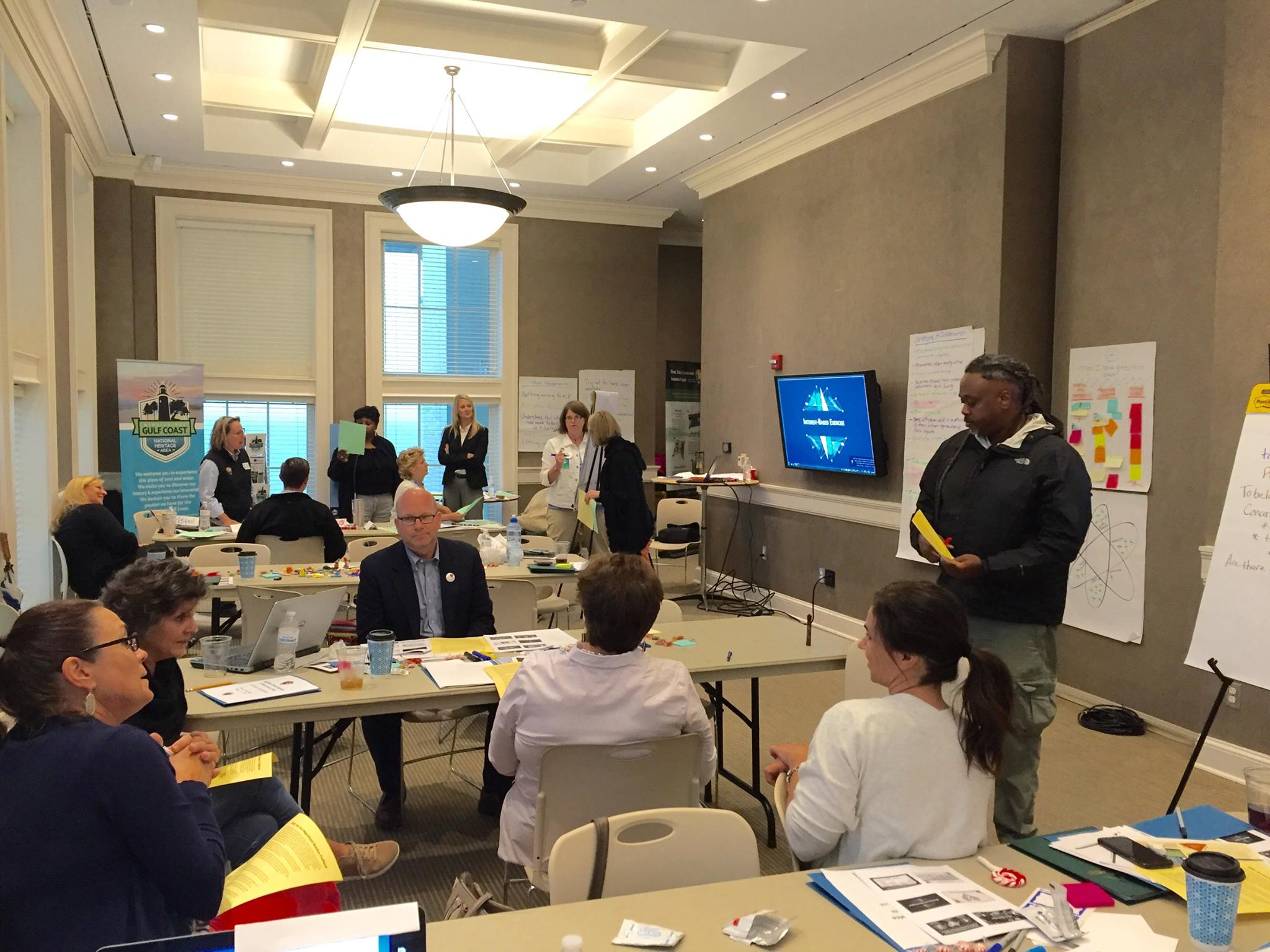 Collaboration Clinic participants from Mississippi and across the country engage in a team visioning exercise at the Biloxi Visitors Center.