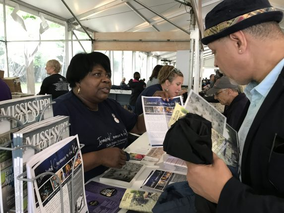 Delta Center team members Shelia Winters and Sarah Hicks distributing information about the International Conference on the Blues and other MDNHA events and attractions.