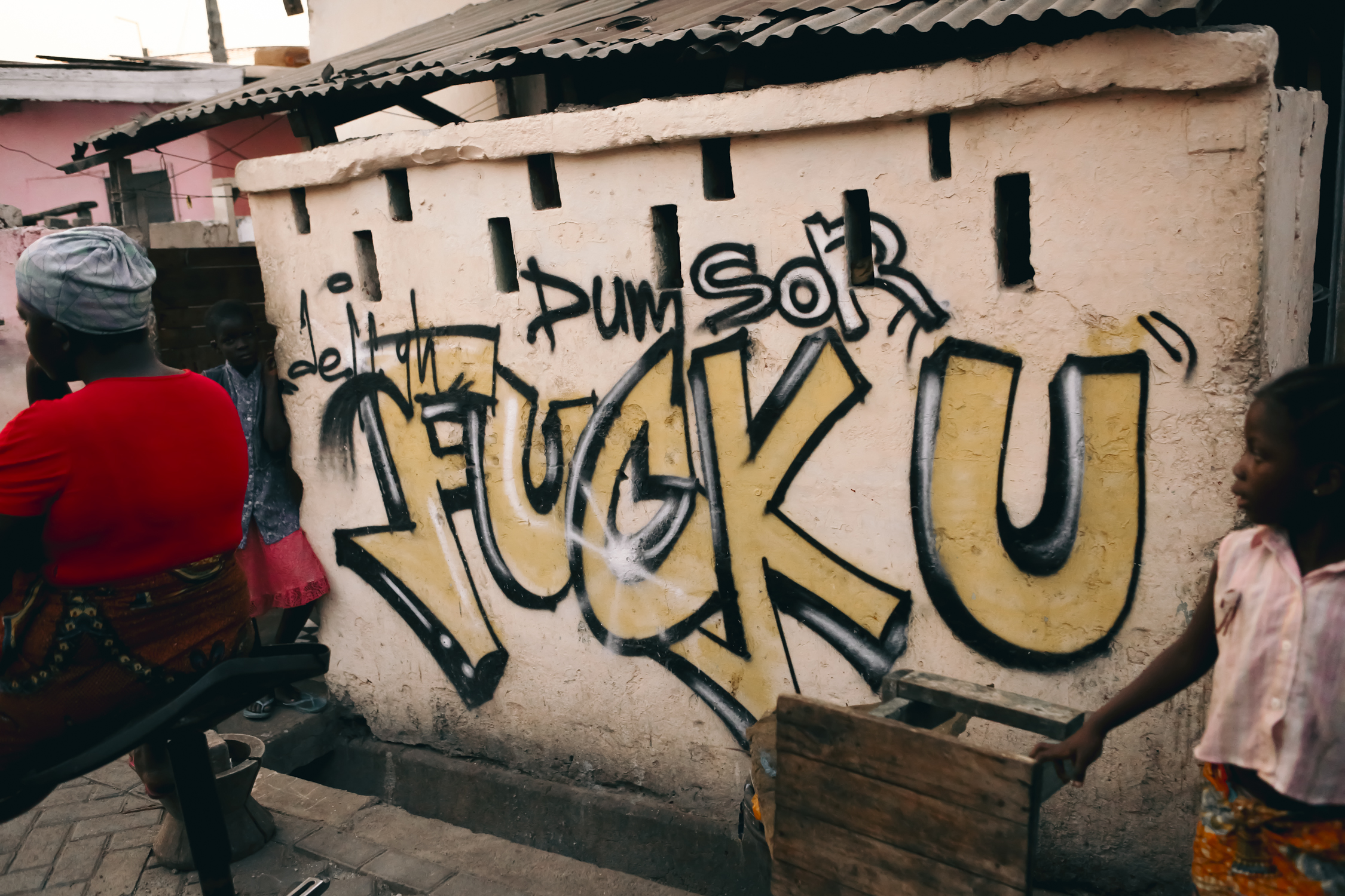 Graffiti artists in Jamestown express their frustration about dumsor, the Ghanaian term used to describe persistent, irregular and unpredictable power outages.