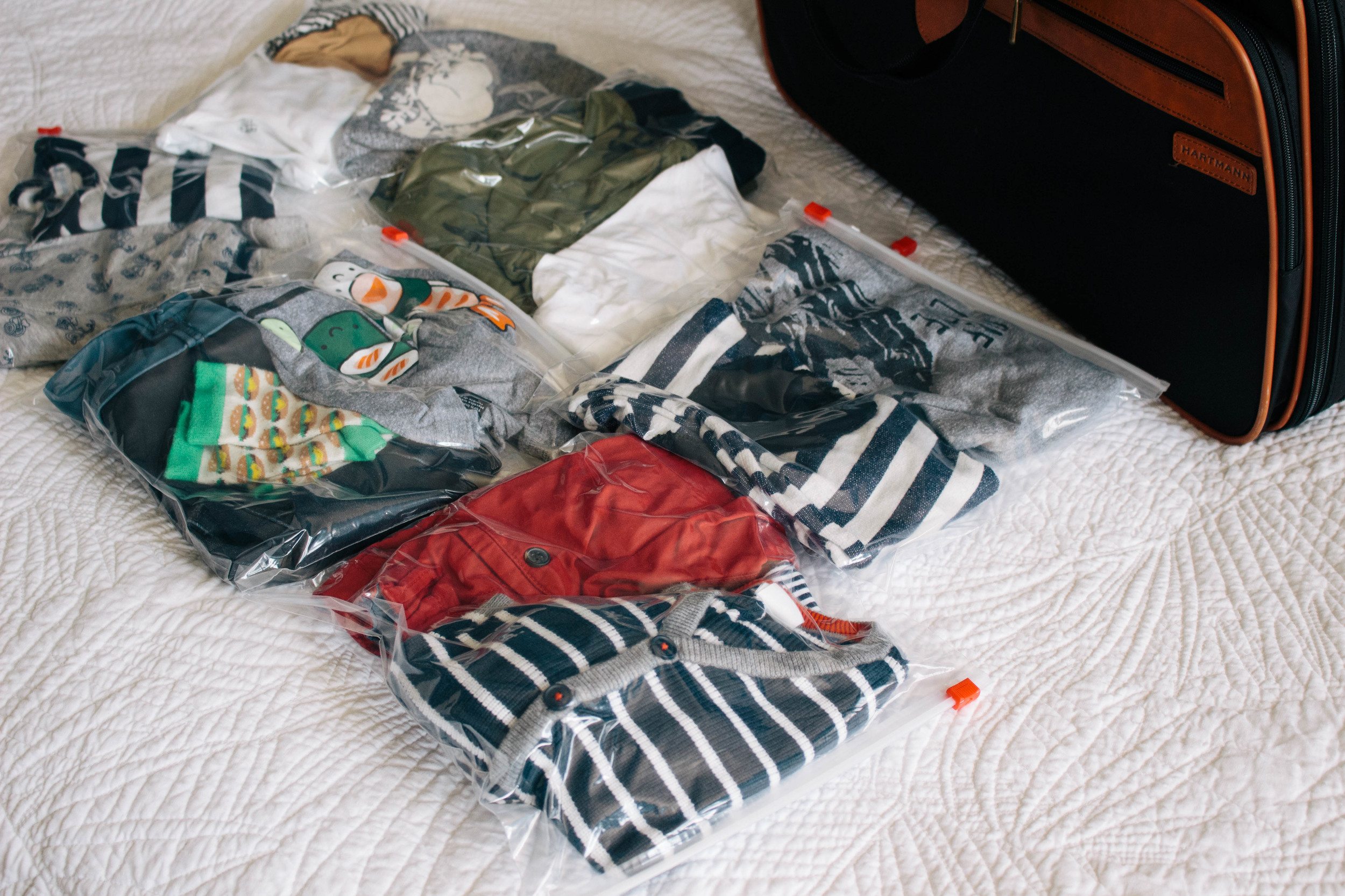 packing with kids, saving space while packing, ziplock bags