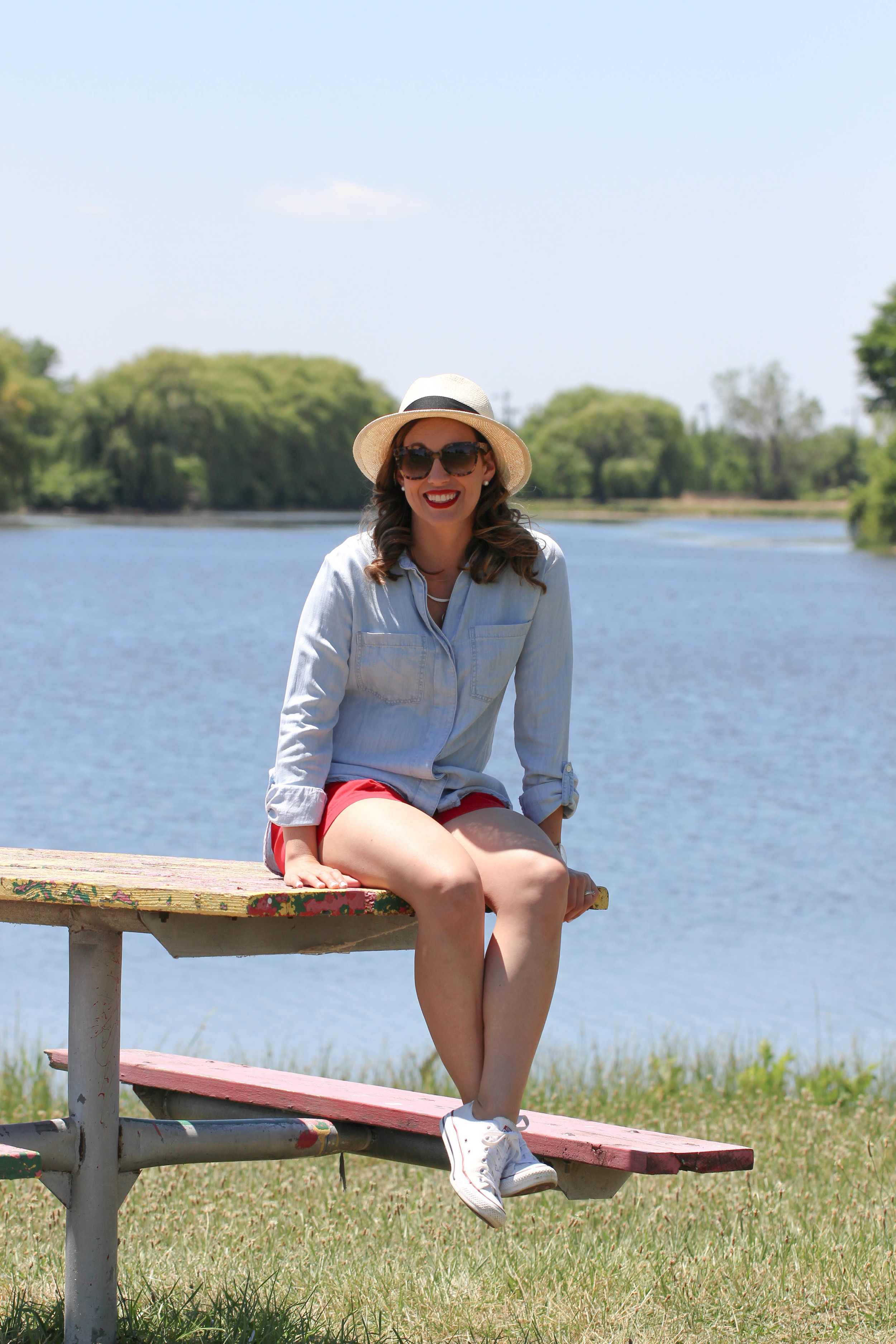 sun hat, tortoise shell sunglasses, red shorts, white converse, chambray shirt, pearls, red lipstick, outfit ideas, outfit ideas for the fourth of july, independence day outfits,