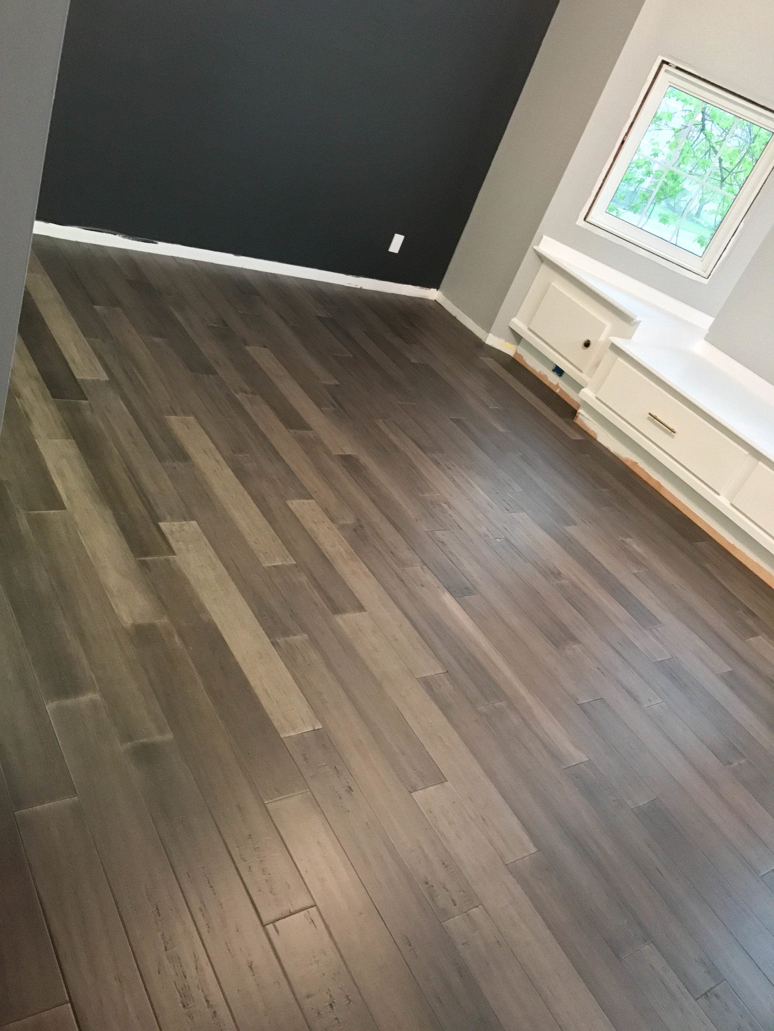 gray hardwood flooring, black wall