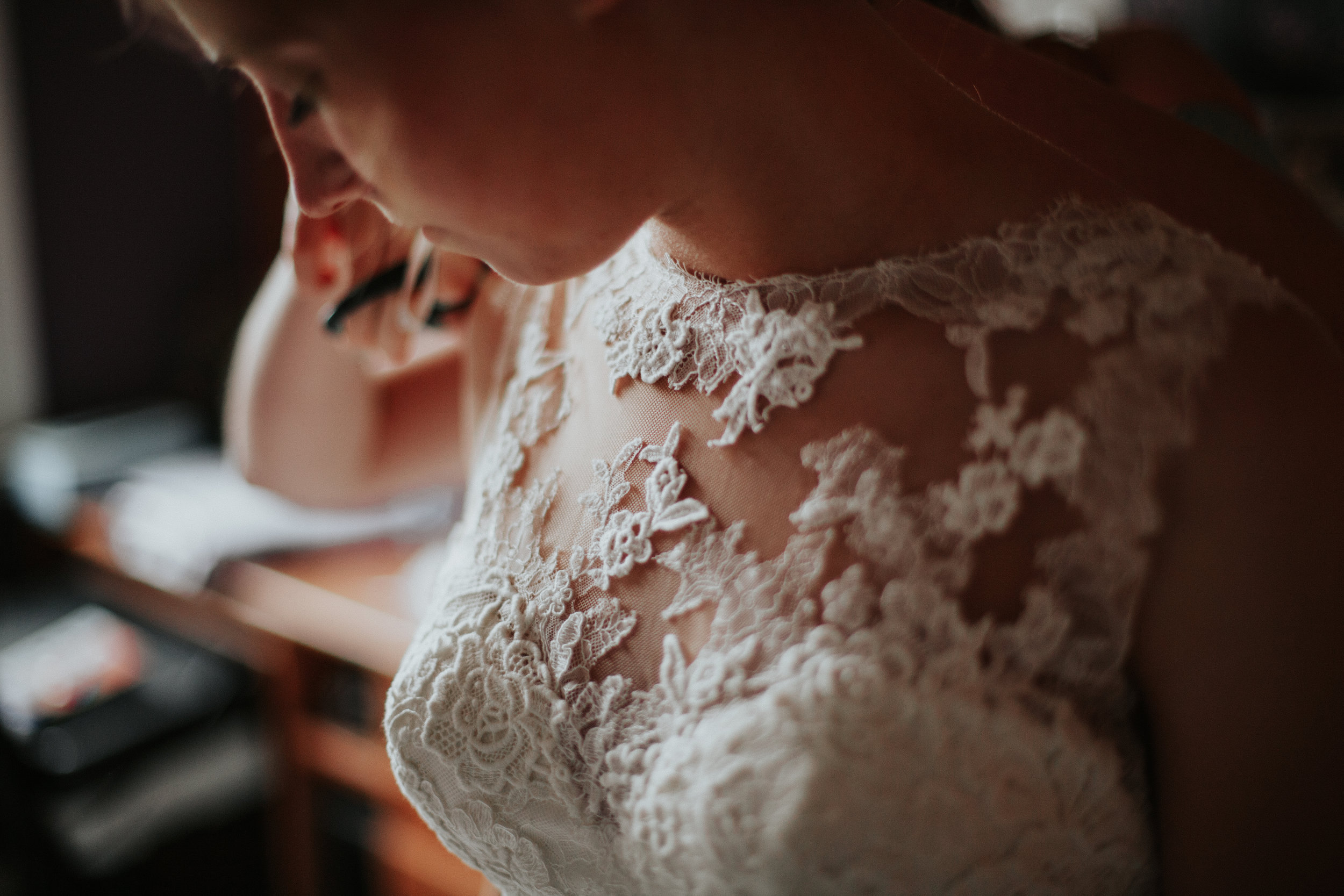 Close up of bride's dress and lace details for wedding in Ghent, Belgium