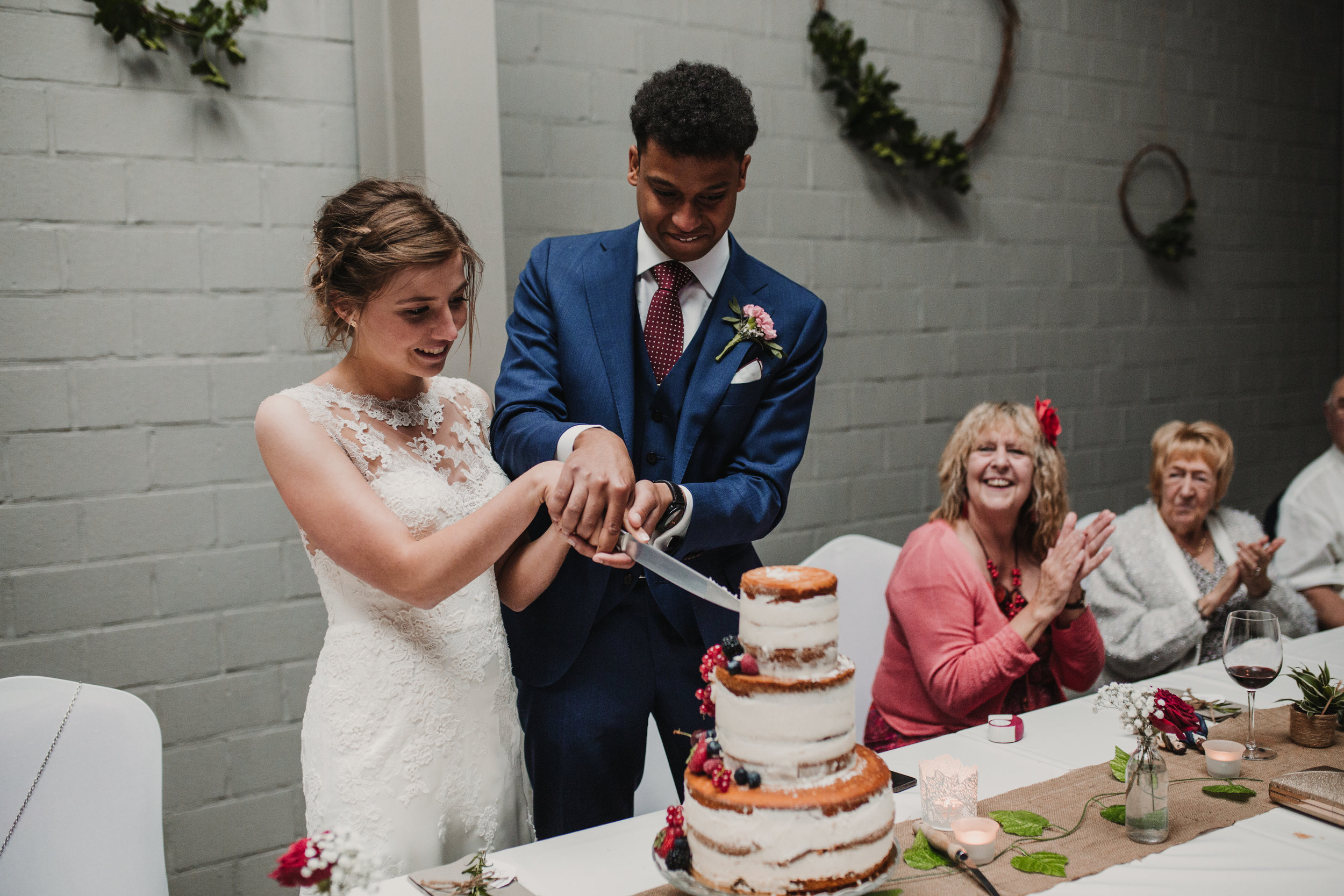 """- David's sister lovingly created their wedding cake and a full dessert spread for their guests. Their reception was not complete without a flash mob, dancing exactly like Kevin Bacon to """"Footloose,"""" and belting out as many ballads as they could."""