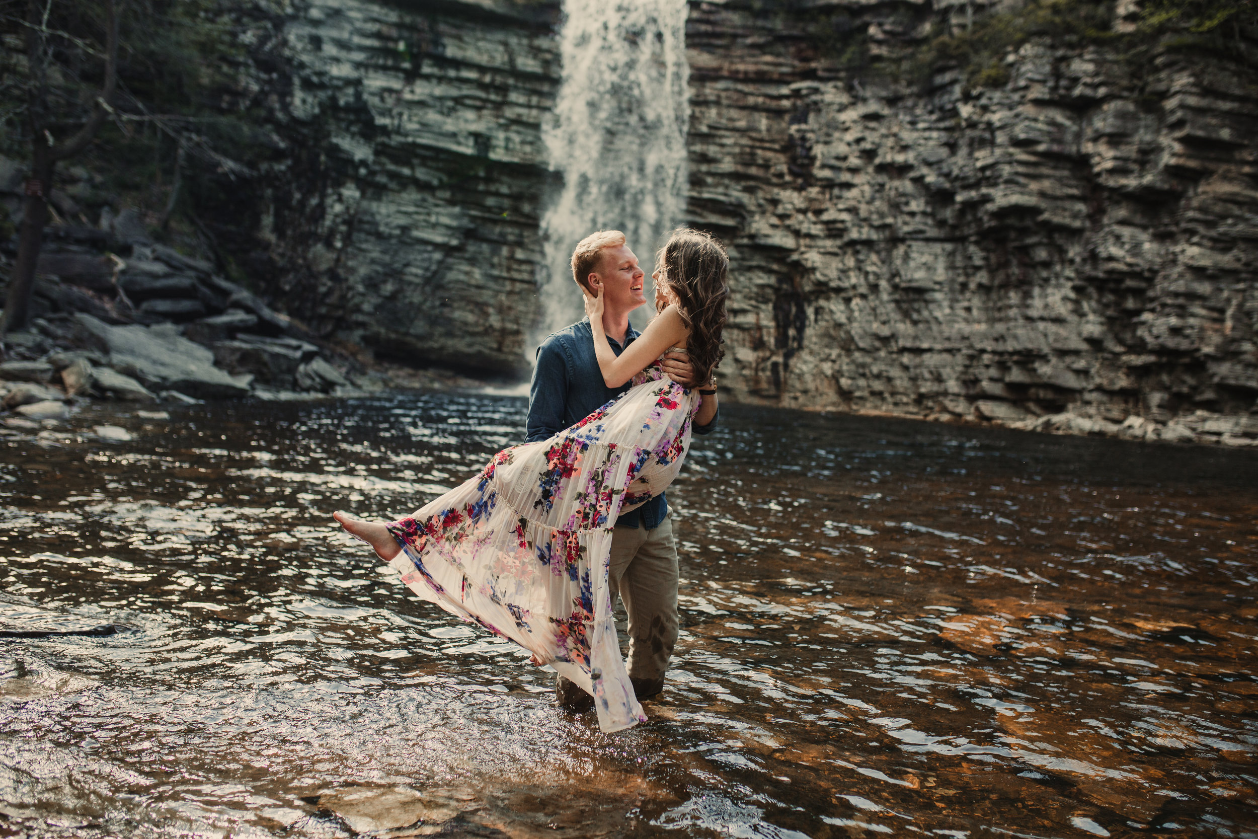Couple in water at the bottom of Awosting Falls in Minnewaska State Park - Gardiner, New York
