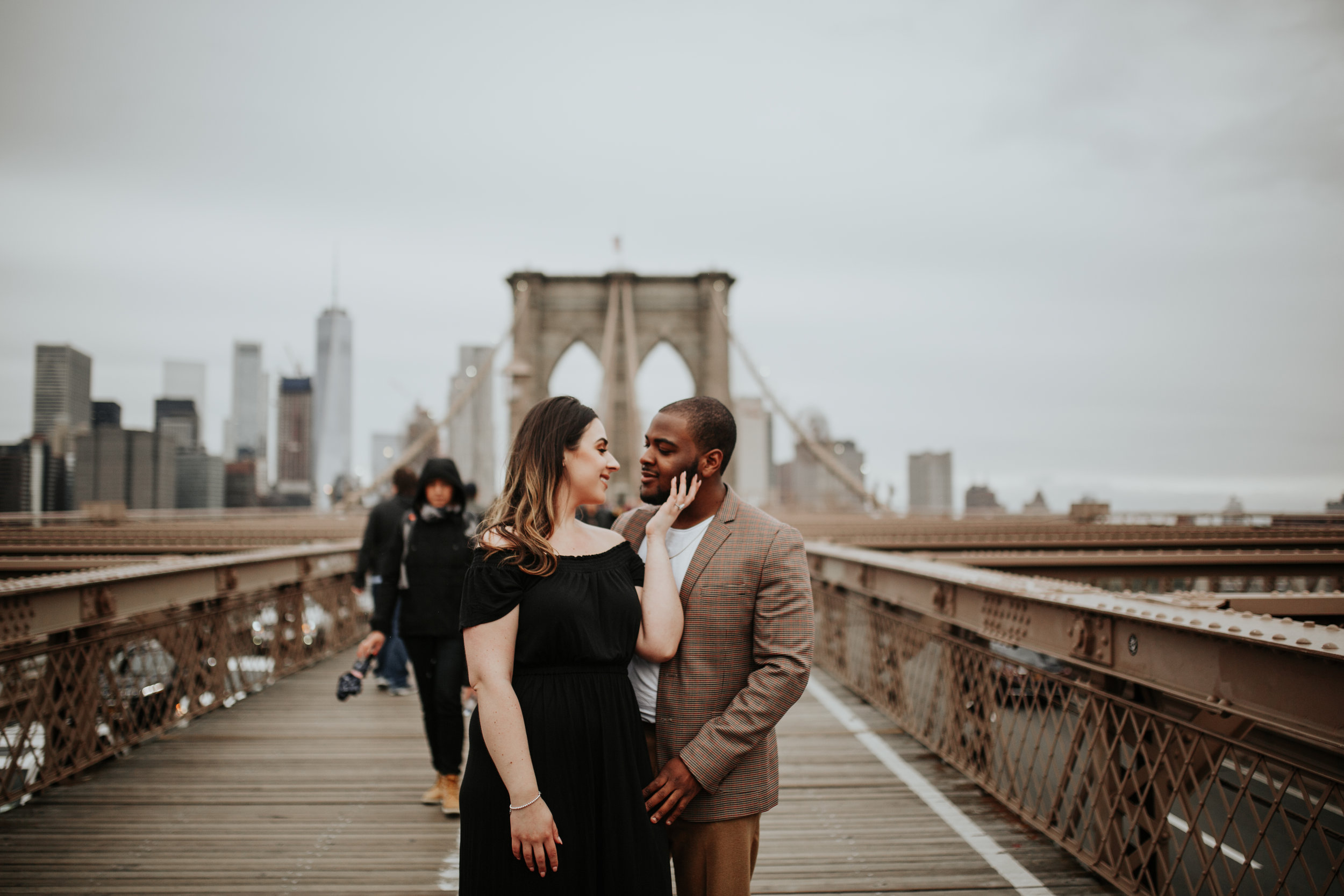 Vanessa & Richard - These two are lovers of all things New York, from Rockefeller Center (where Richard proposed) to DUMBO and Tribeca, where we had their engagement session. Each outfit matched perfectly with the vibes of the city and they brought the sexy to the city.