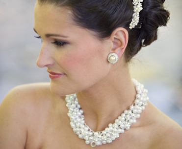 Pearl-Earrings-Necklace-Comb-on-bride.jpg