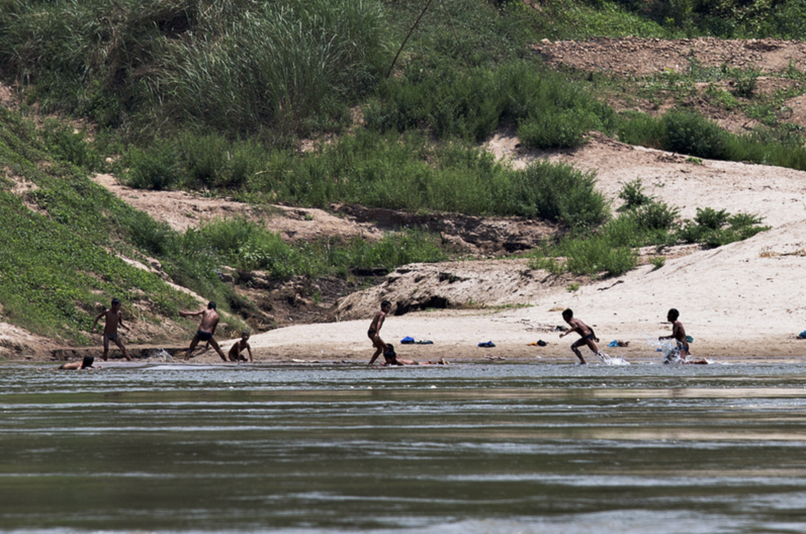 Hilltribe children play in the river.