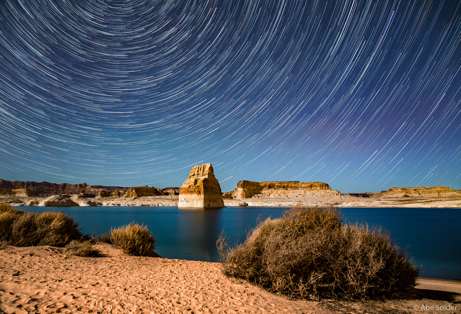 This image was my very first star trail image taken at Lake Powell on Valentines Day when me and Tiffany were camping by the lake. The landscape is lit up from moonlight which gives it a very different effect.