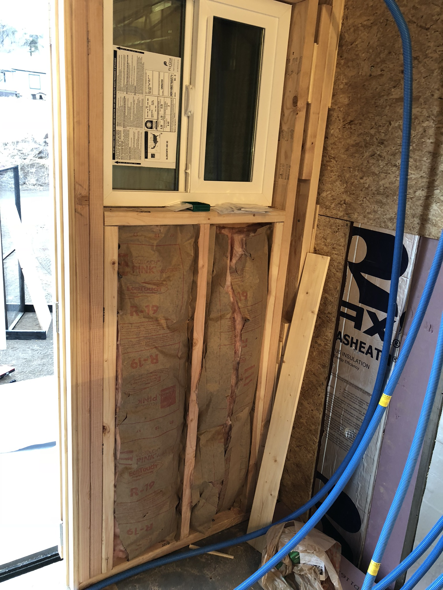 Time to insulate - We used typical R-19 house insulation for the back wall. Our windows are also double paned which will help on hot or cold days.