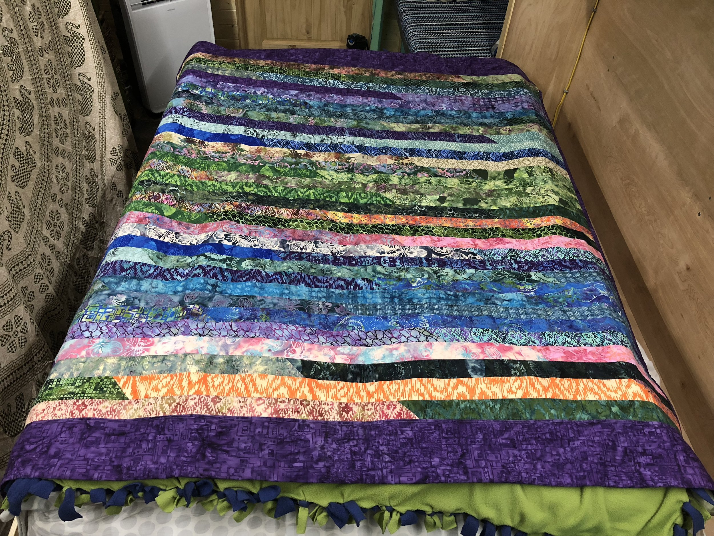 This is the stuff that makes it a home. - Abe's mom made us this incredible quilt for our bed. We just need to figure out a way to display it when the bed is up.