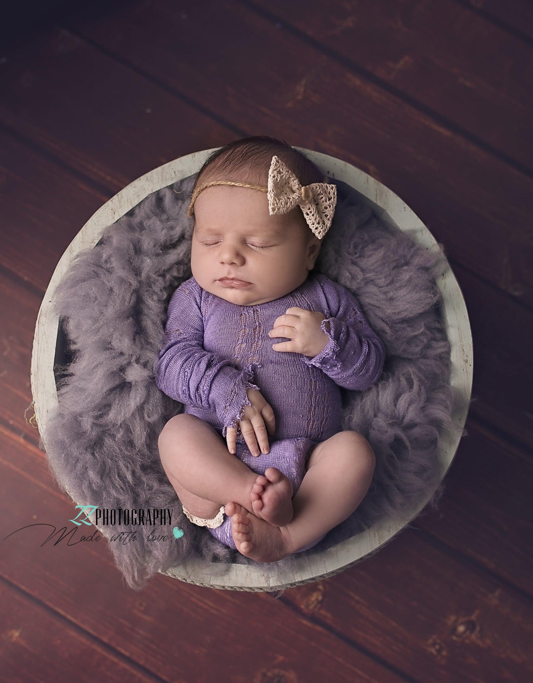 newborn girl sleeping in the bowl Exeter
