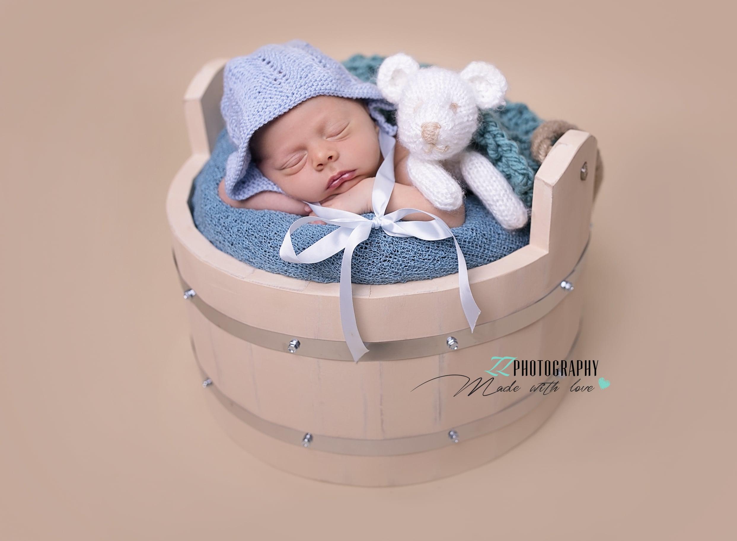 newborn boy with a little teddy