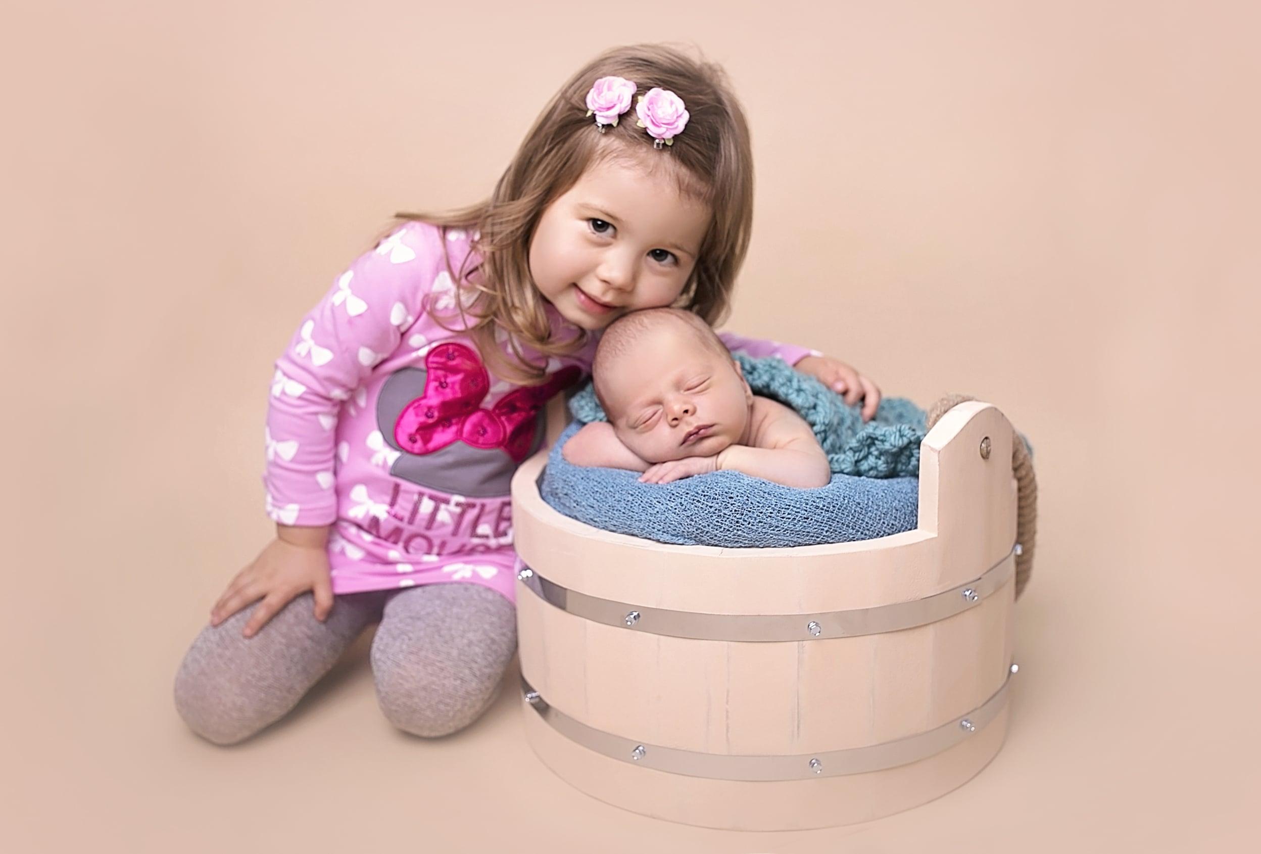 newborn boy with a big sister