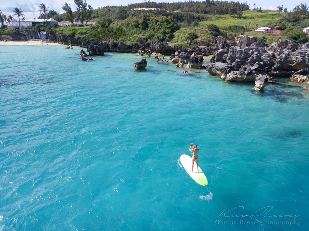 Stand-up paddle boards on the crystal clear waters near Achilles Bay