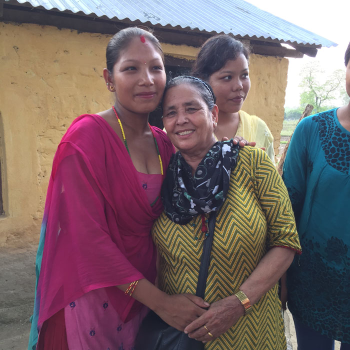 Shanta with two women in the community