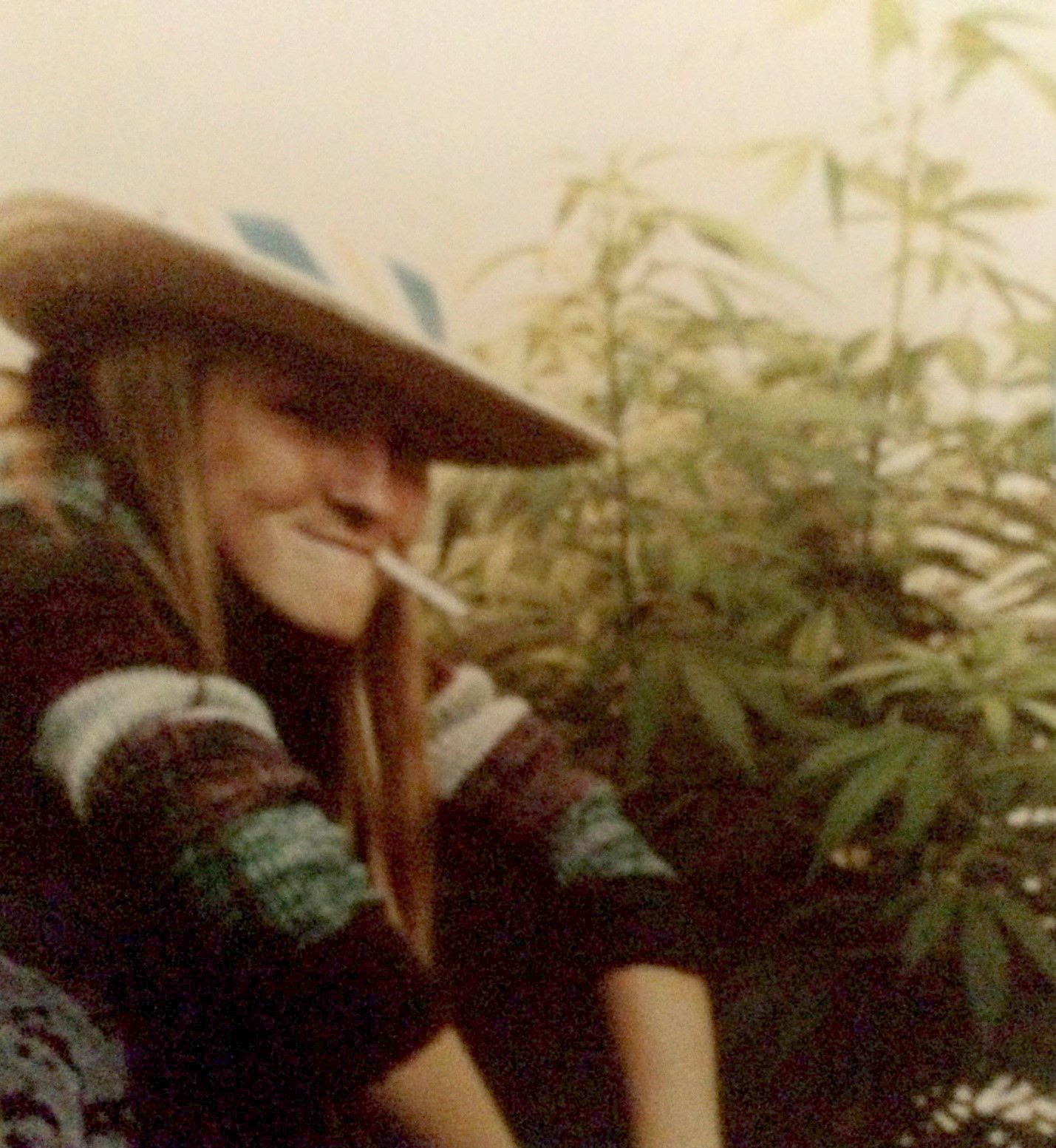 Letts at 16, yucking it up by some plants she grew in her mom's rose garden