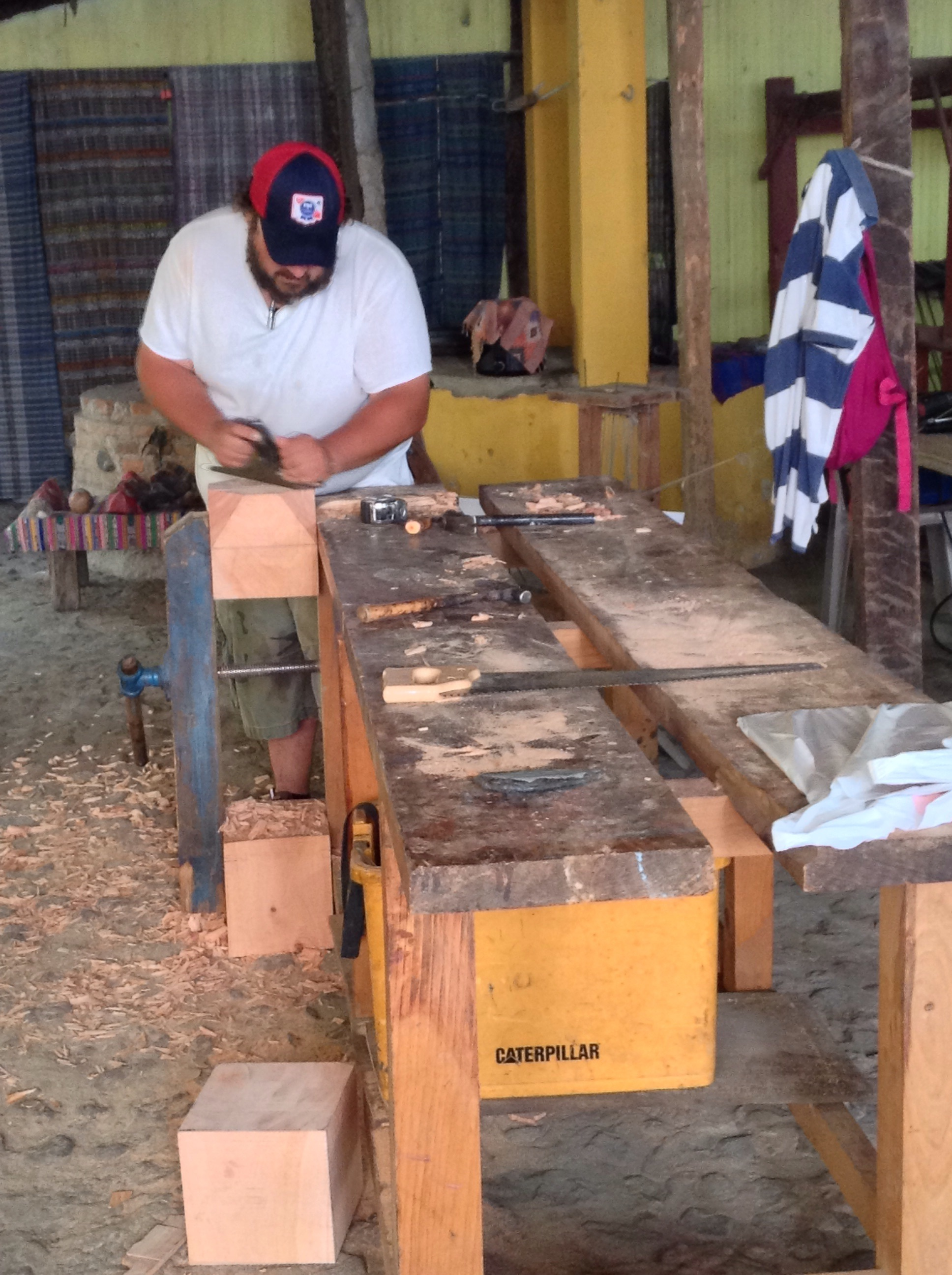 Joshua Knoblick working with wood.
