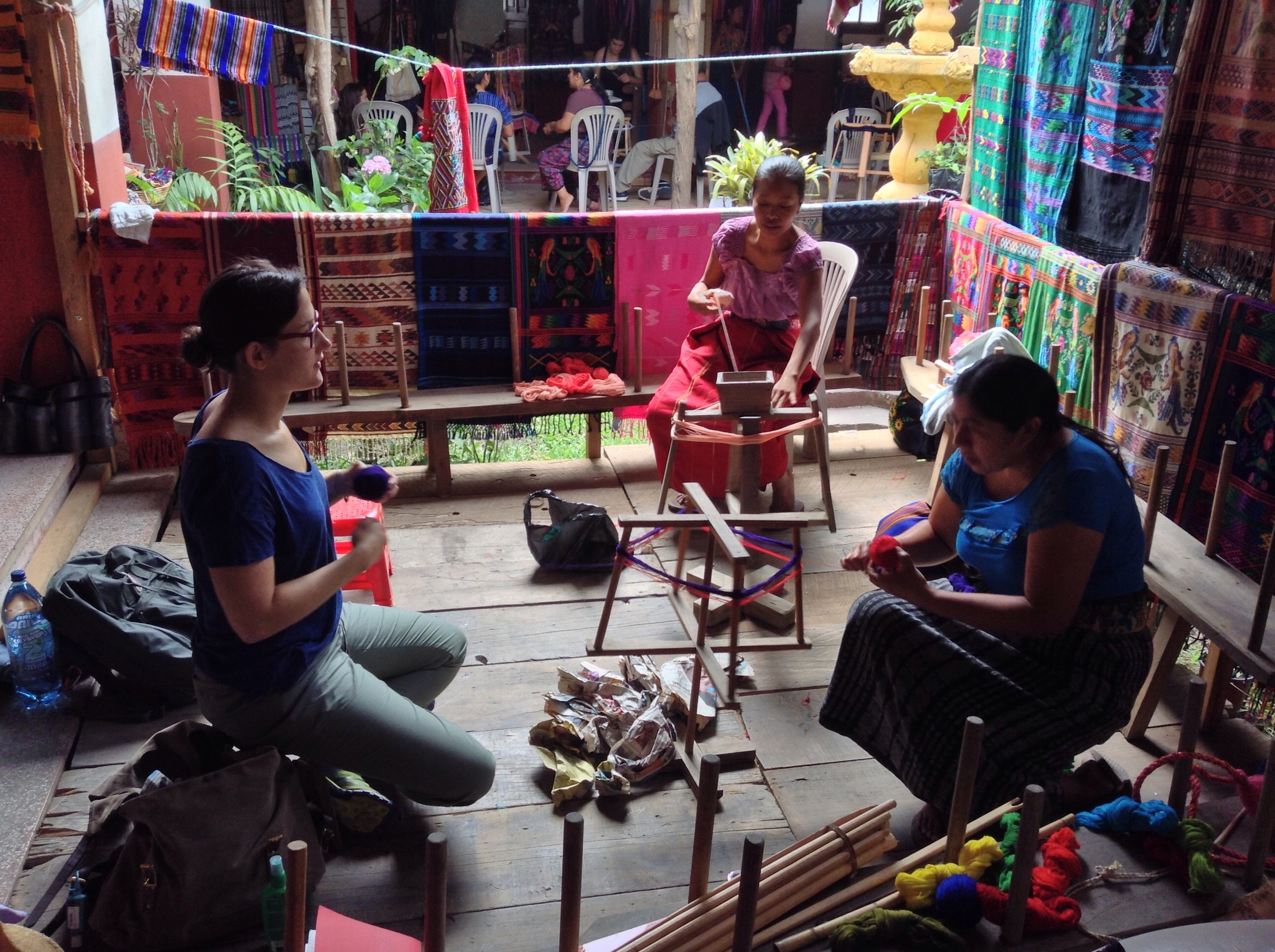 Part of the process of weaving involves unraveling skeins of thread and rolling them into balls.