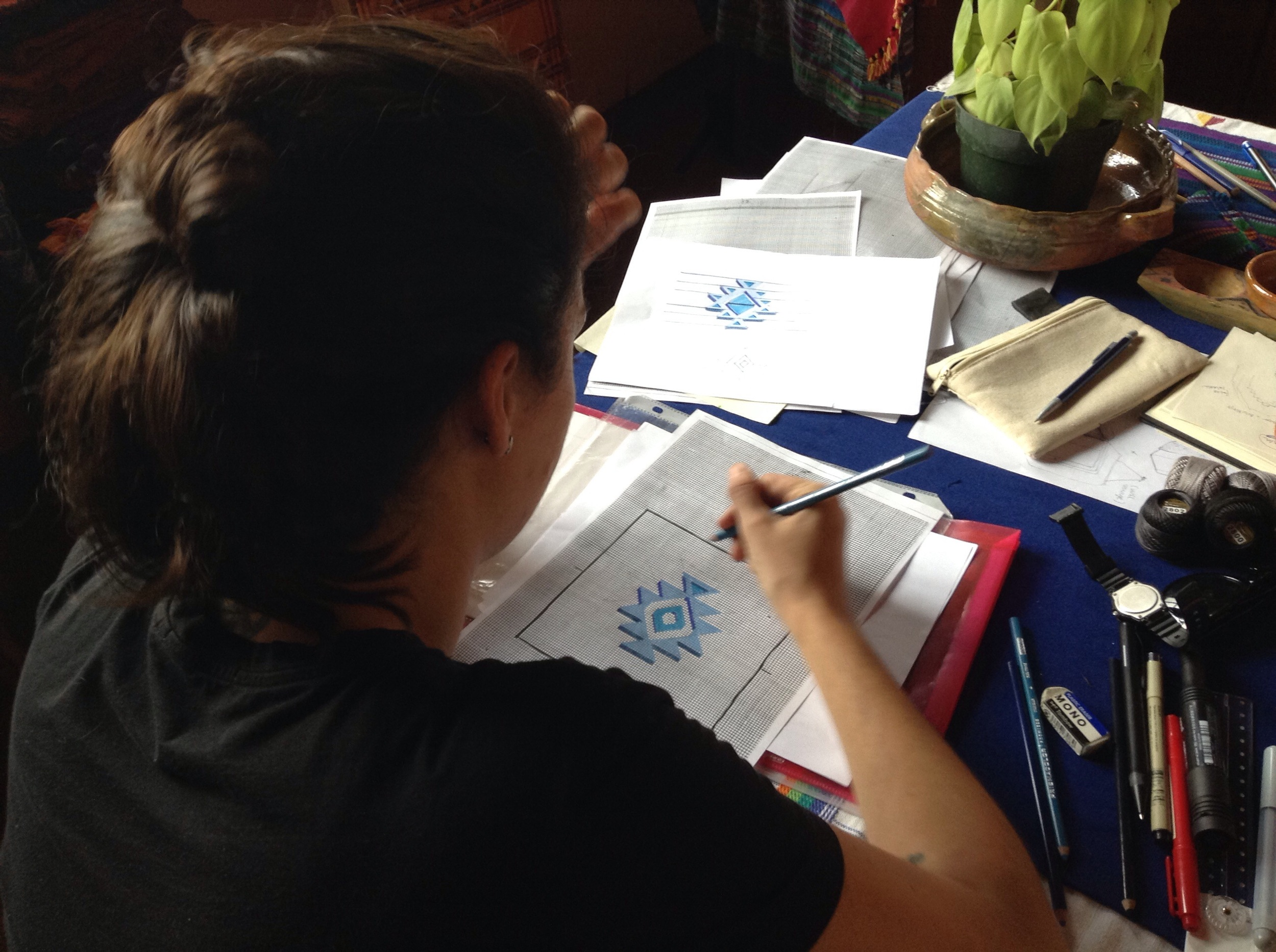 Designers sketched out their ideas on grid paper for original textile designs. Here, Aldana is mapping out her textile design.