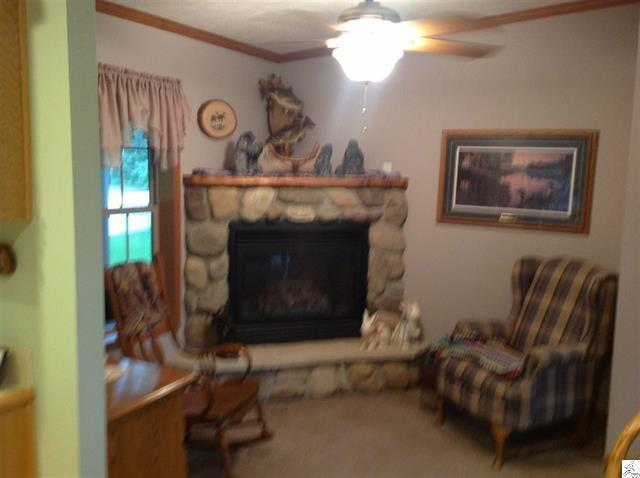 3773-skog-road-kettle river-stone fireplace.JPG
