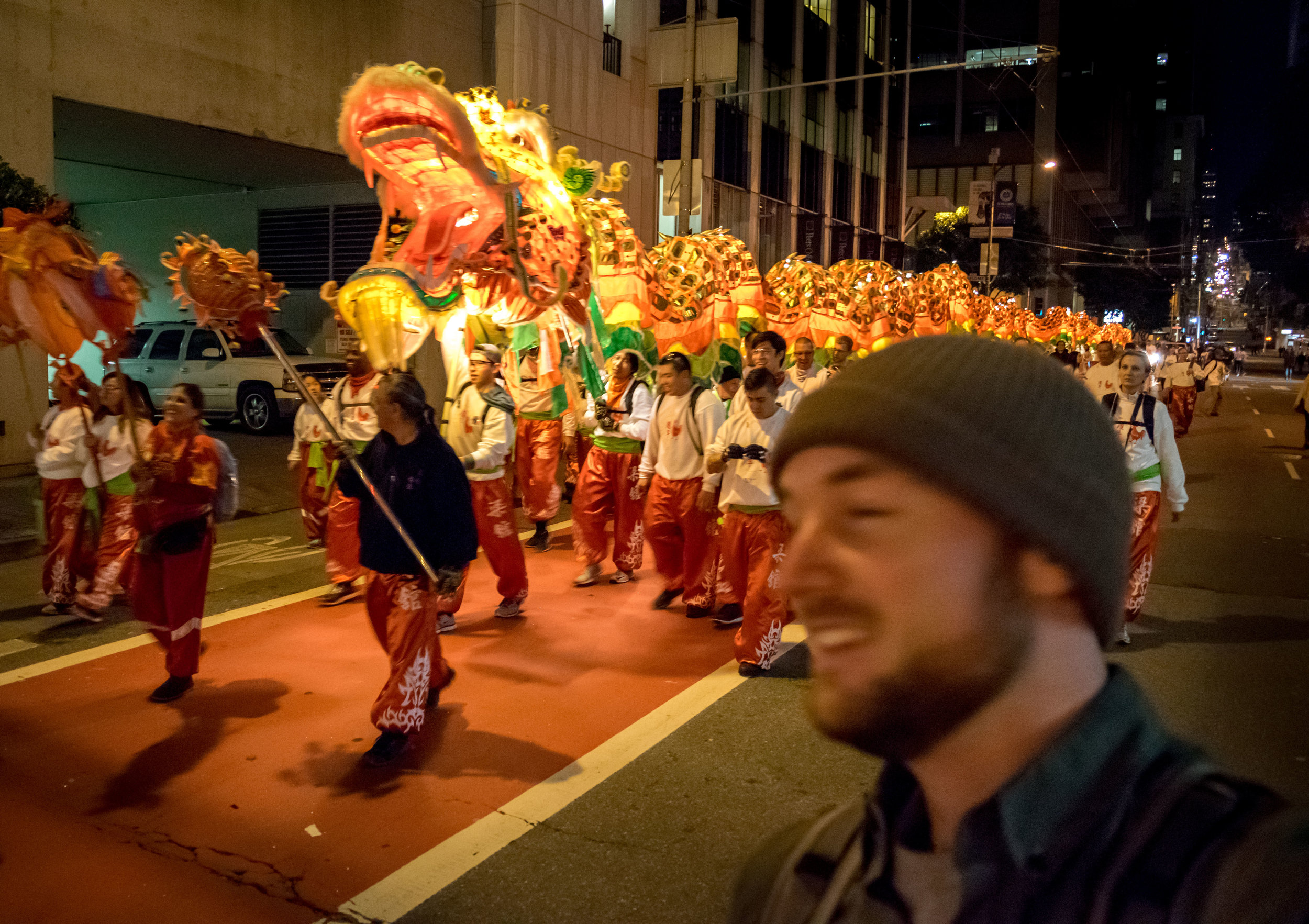 The parade was over; The dragon left the official route to go back to its home and, strangely, so did the crowds allowing just a few people—including myself—to walk with it.