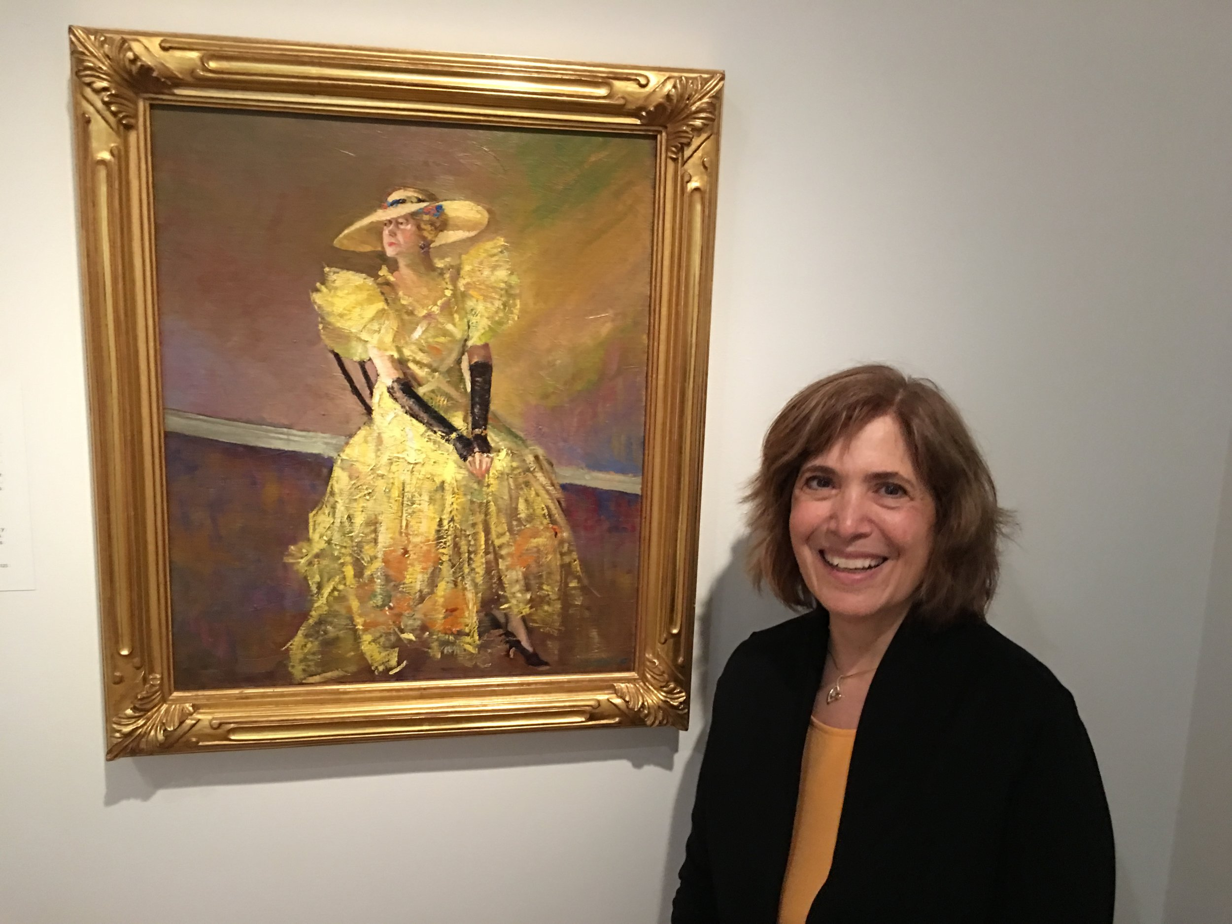 Nancy with a Laura Wheeler Waring painting of Alice Dunbar Nelson at the Smithsonian Institution's National Portrait Gallery in Washington D.C. The painting is reproduced in the book, 'Beautiful Shades of Brown,' illustrated by Felicia Marshall