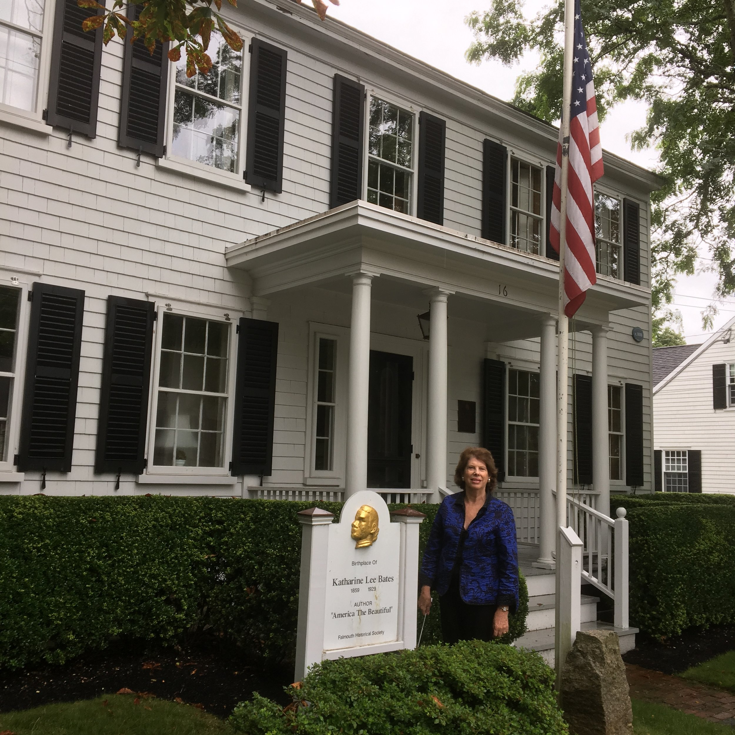 Melinda M. Ponder at the house where Katharine Lee Bates was born and raised in Falmouth, Massachusetts