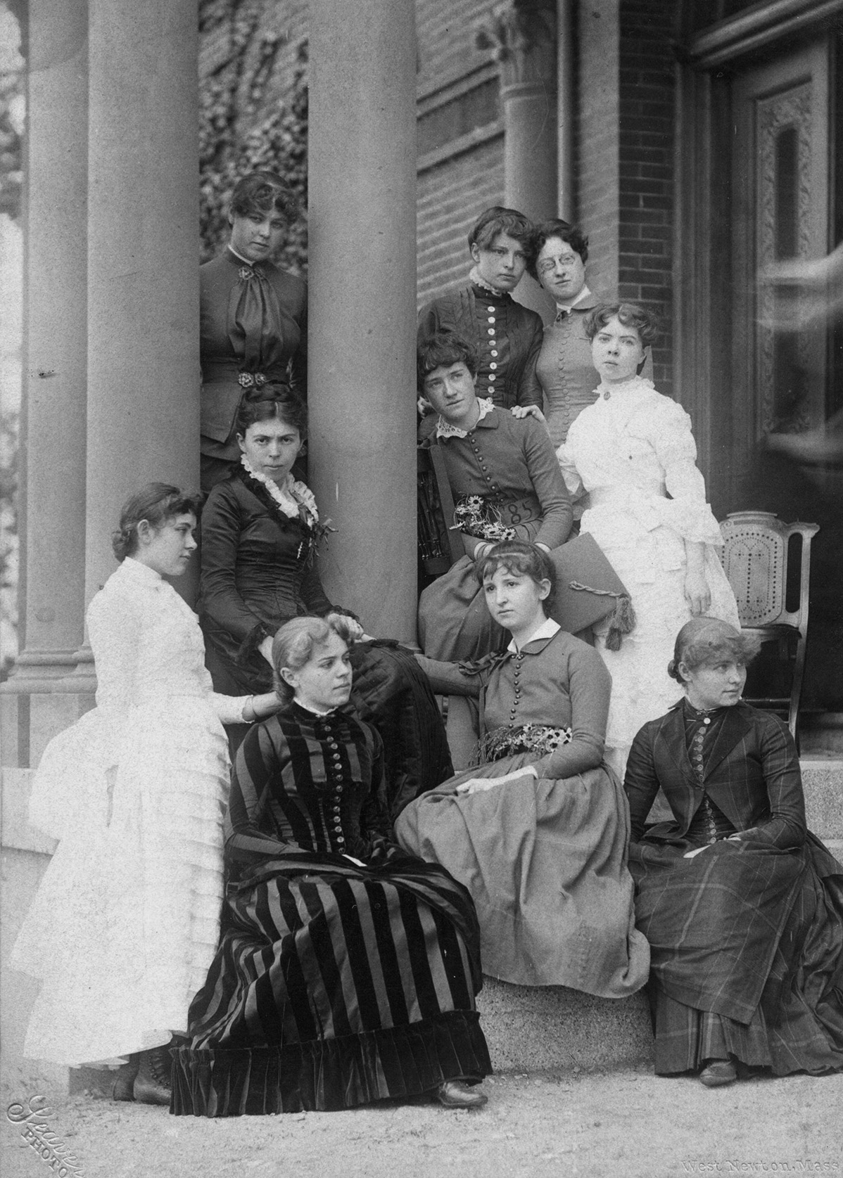 When Katharine returned to teach at Wellesley in 1885, she was greeted by young president Alice Freeman, second from left standing next to the column, appointed when she was 26 years old. Photo courtesy of Melinda M. Ponder and the Wellesley College Archives