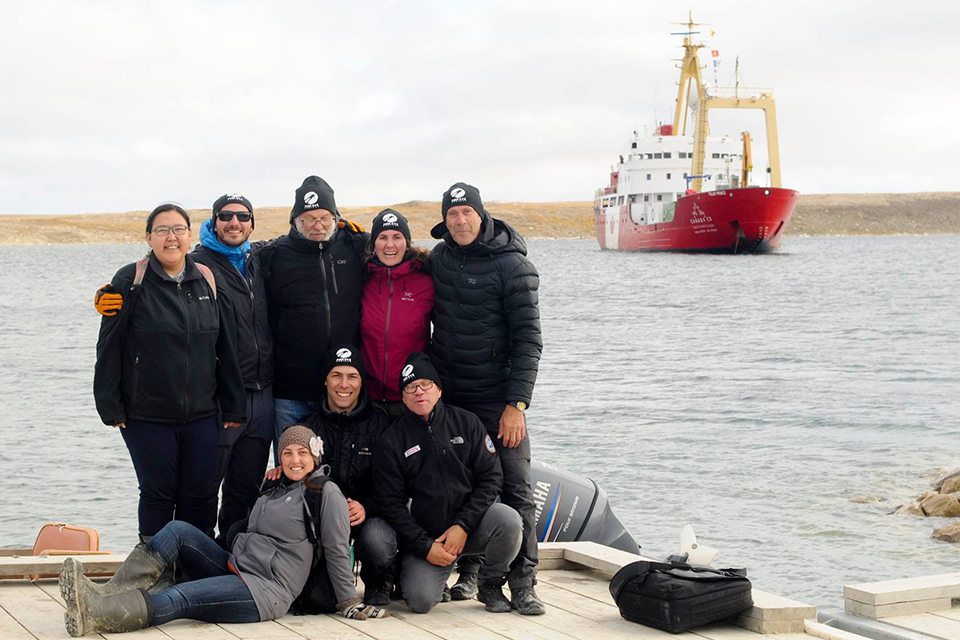 The Fish Eye Project team celebrates a successful live dive in Cambridge Bay, Nunavut. Photo: Peter Spence / Students on Ice Foundation
