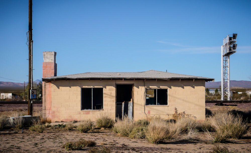 An abandoned building next to the train tracks in Goffs, CA.